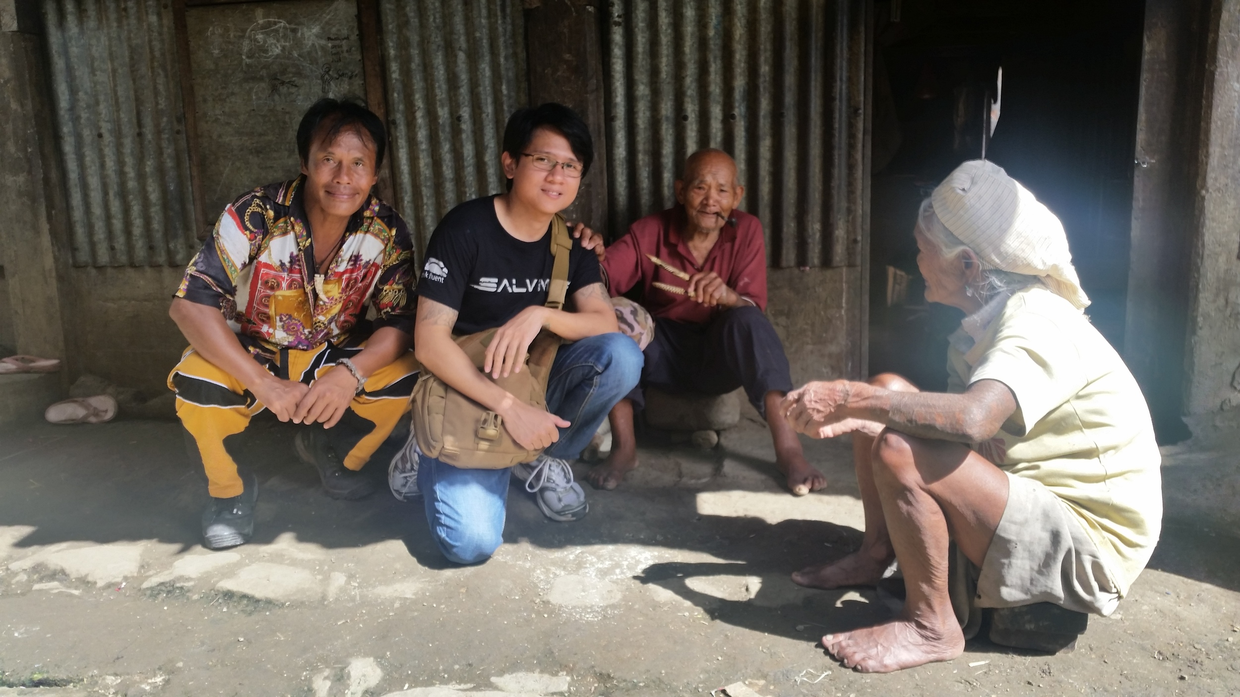 Francis Pa-In and Nico with the Pipe/Broom makers of Buscalan village