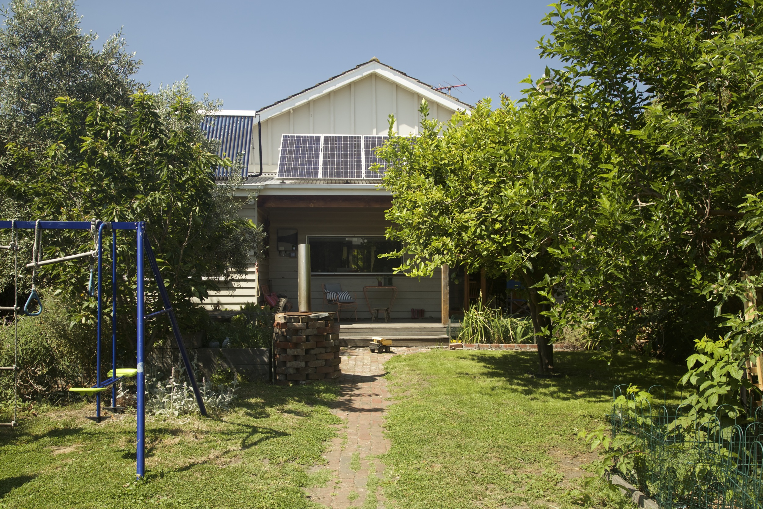 The owners of this inner north Victorian weatherboard have installed insulation, solar hot water, photovoltaic panels, rainwater tanks, efficient heating and ceiling fans since having a home sustainability consultation with Brave New Eco.