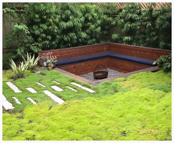 Magical back garden hideout with a moss lawn and sunk-in lounge by Collecting Flowers | San Francisco Bay Area Custom Garden Design