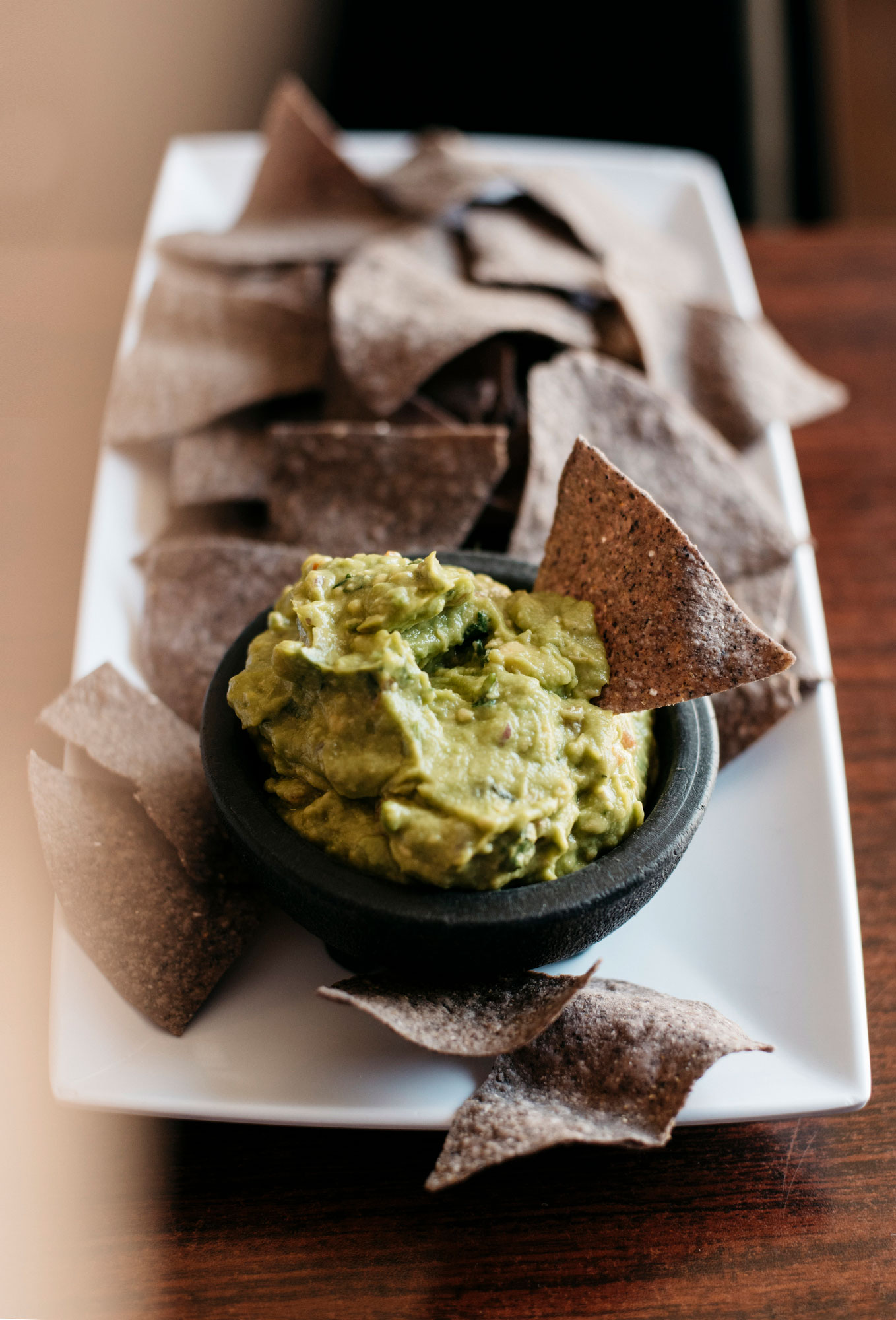 Guacamole and handmade blue corn tortilla chips