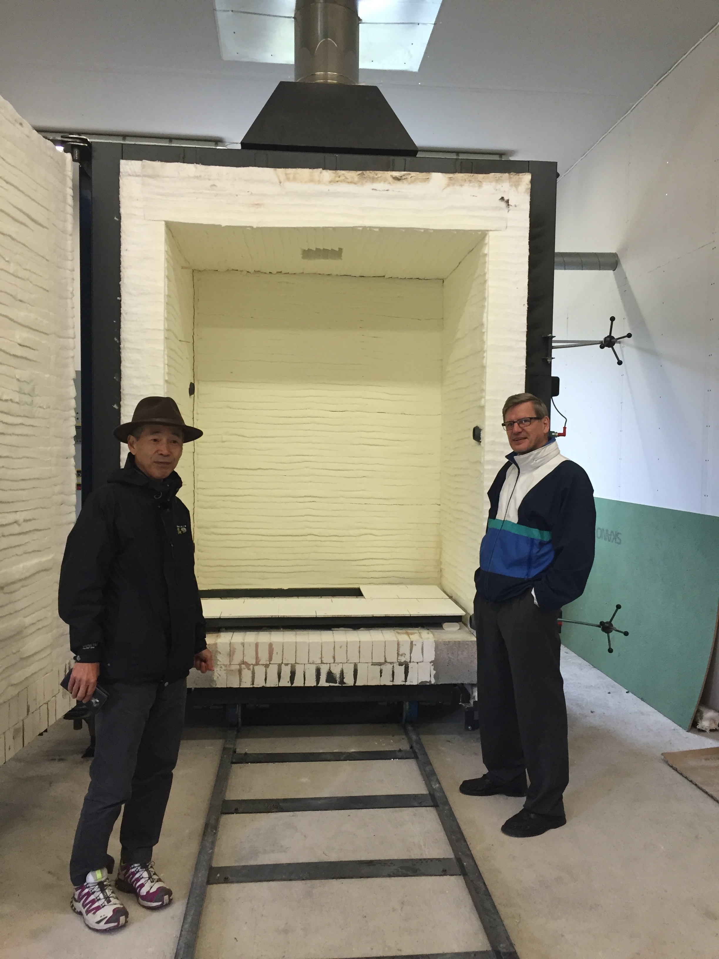 Suku Park and Reijo Lantto with the new kiln at the Arctic Ceramic centre