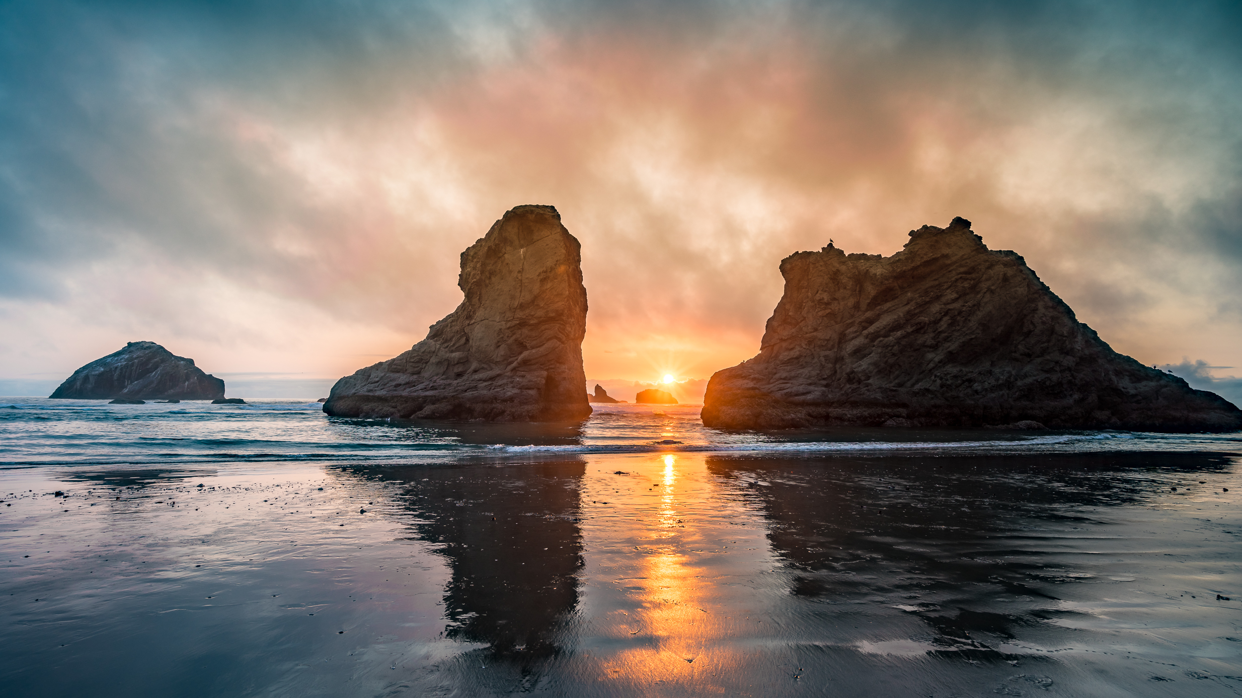 "Brandon Beach sunset through the ""sea stacks"""