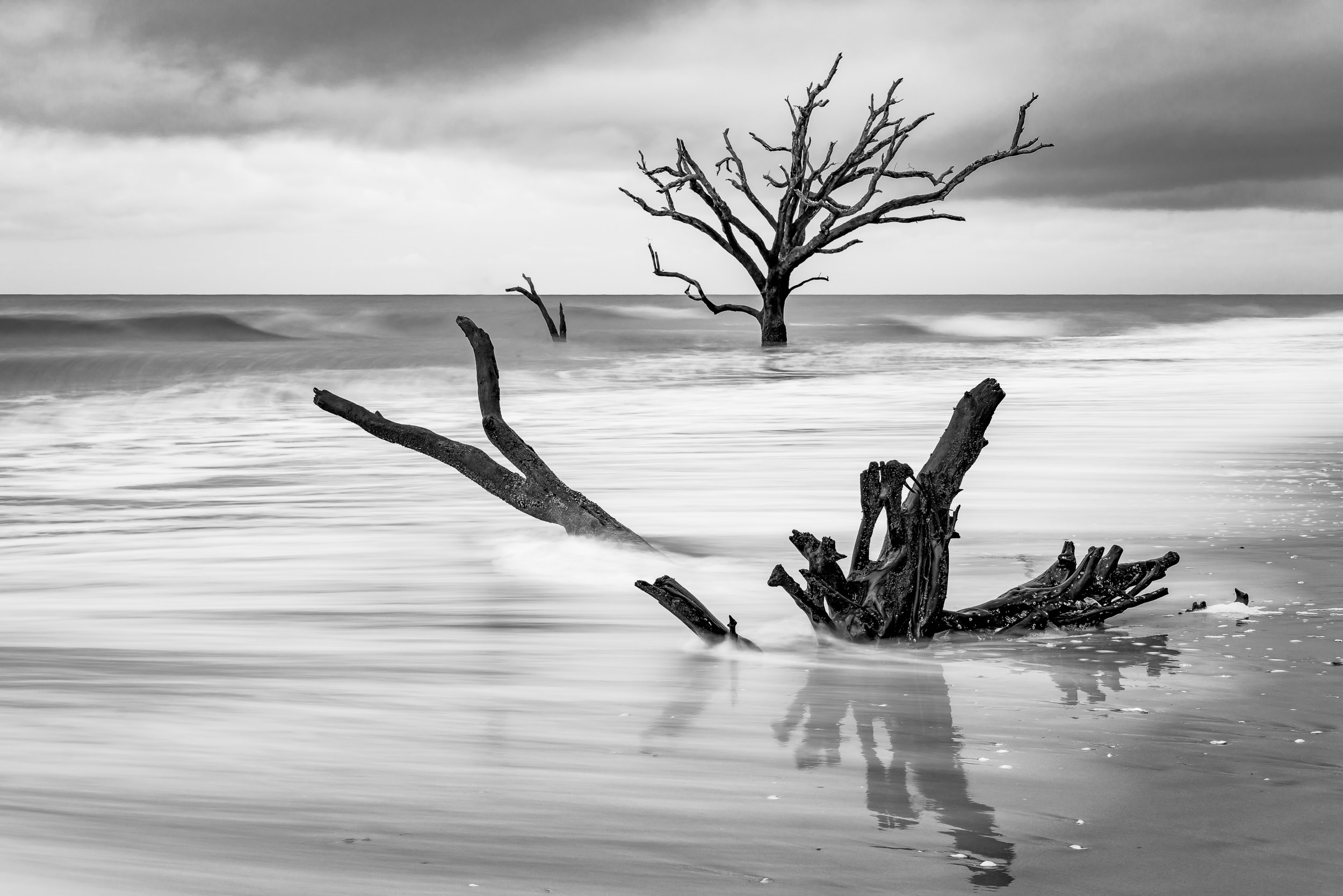 2 seconds to capture long lines as the wave retreats to the ocean at Botany Bay Plantation.