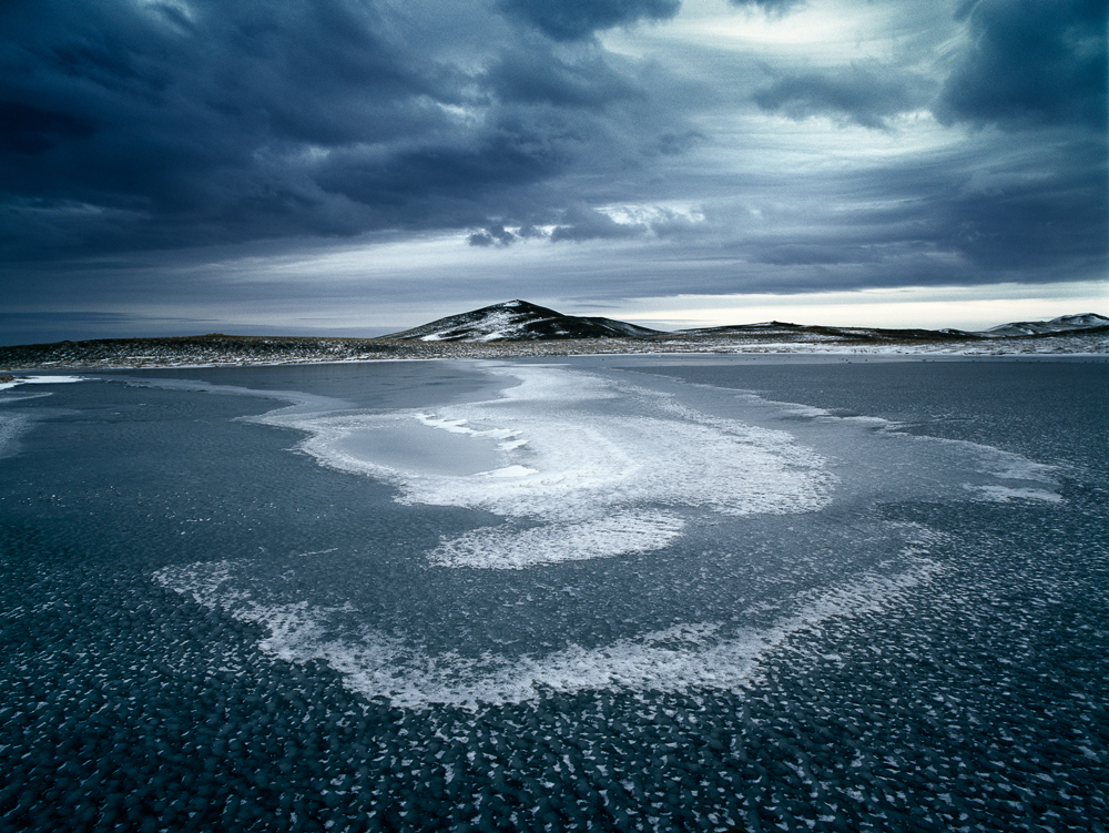 Caption: Ice Smile, Location: Near Jokulsarlon, Iceland, Camera: Hasselblad H1, Lens: Hasselblad HC 35mm, Film: Fuji Velvia 50, Exposure: 0.5s, Aperture: f/16, ISO: 50, Filters: No