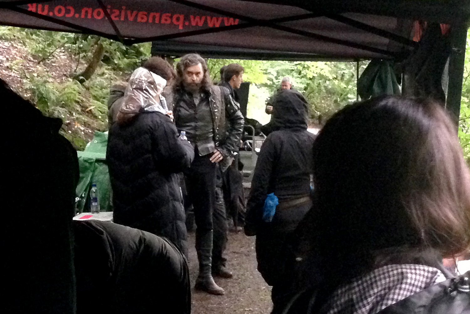 The cast & crew discussing the next scene between takes.