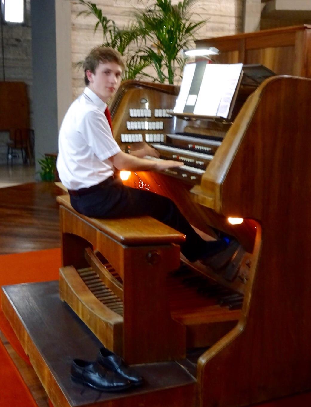 The shoeless organist entertains