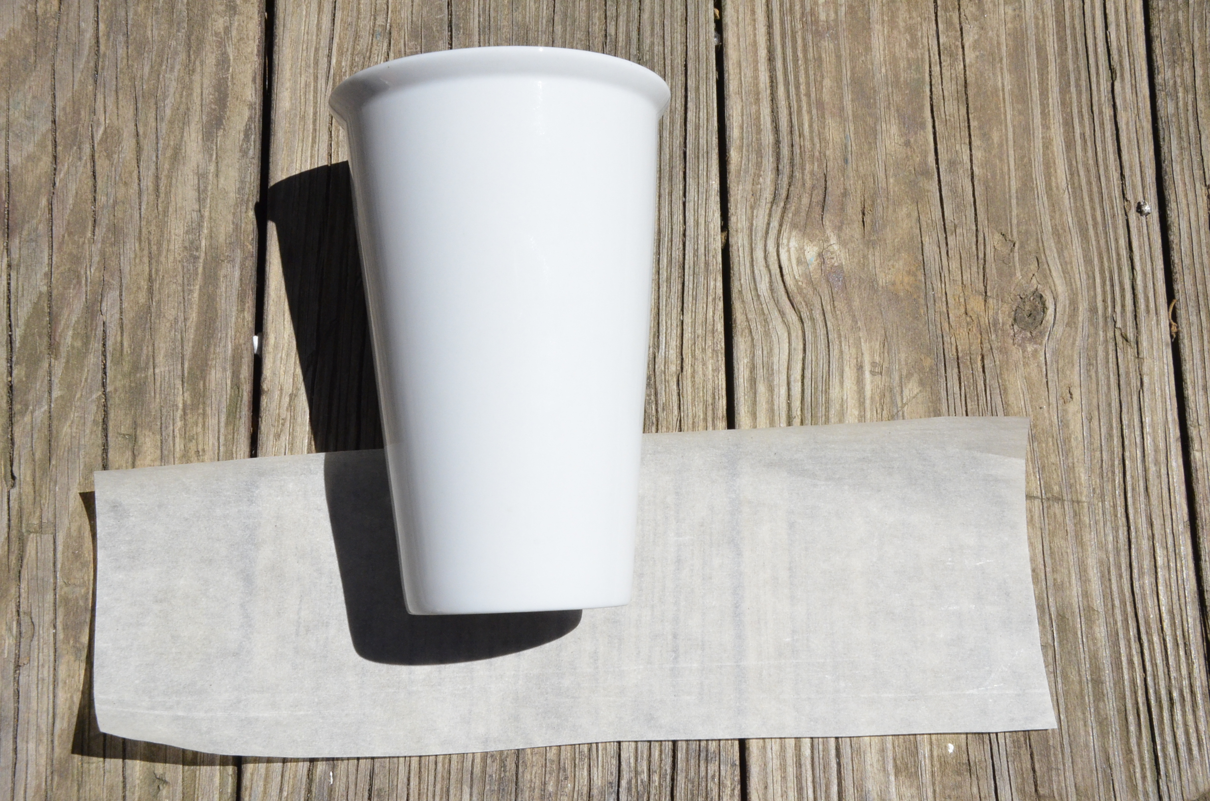 We like to start with a flexible paper, like the wax paper that comes with your decal.
