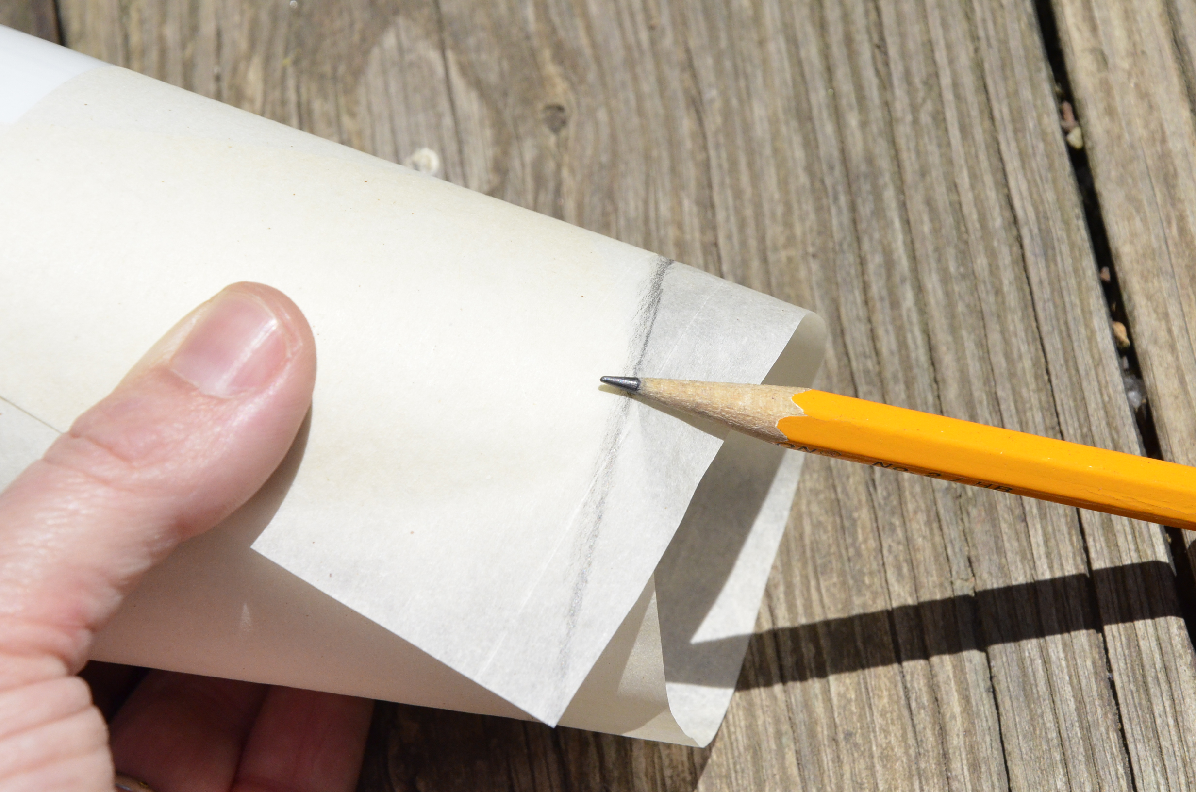 Use the side of a sharpened pencil to trace along the cutting edges.