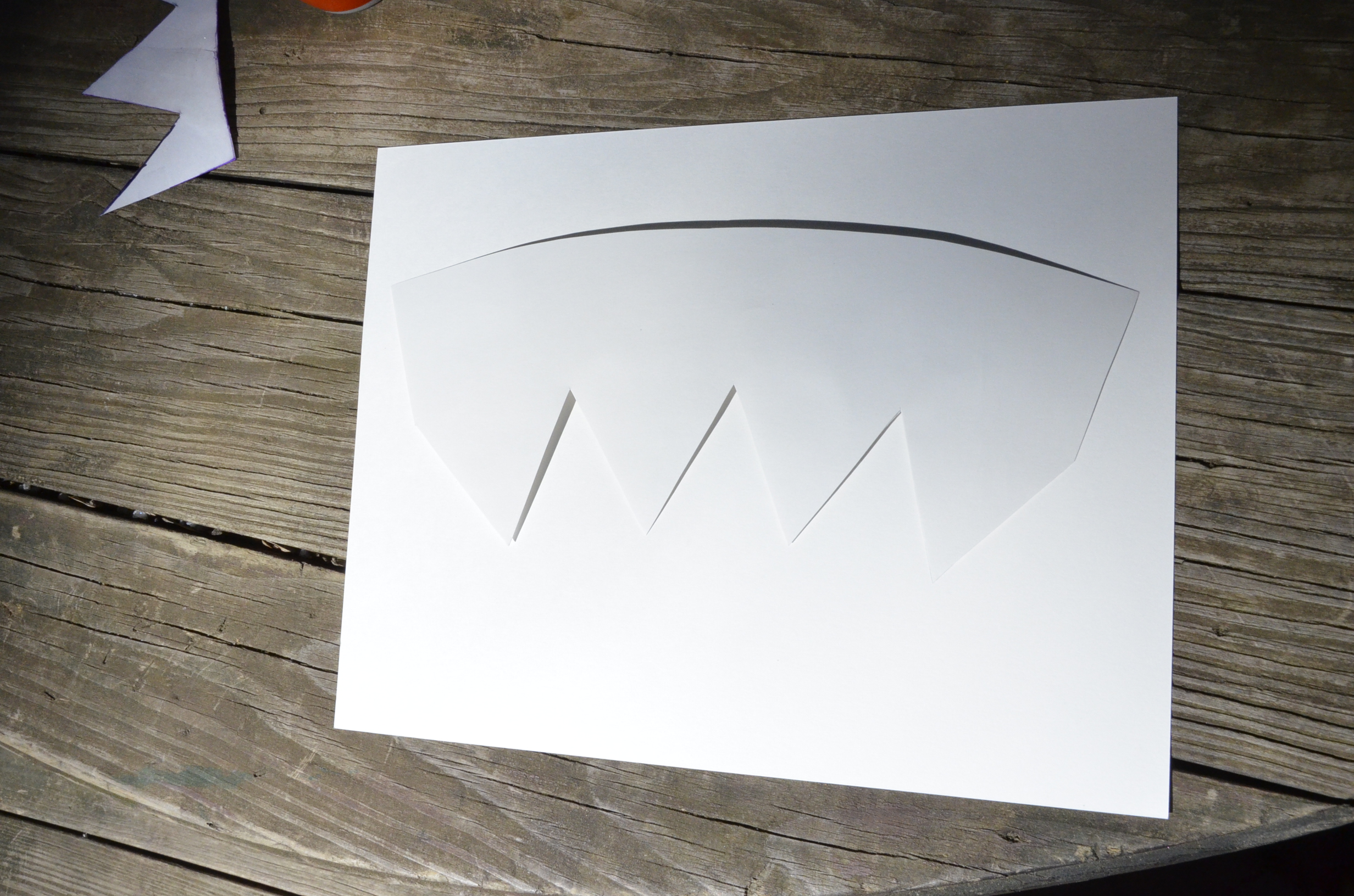 Heavy-weigh paper template is taped to the backside of the decal sheet to trace for precise cutting.
