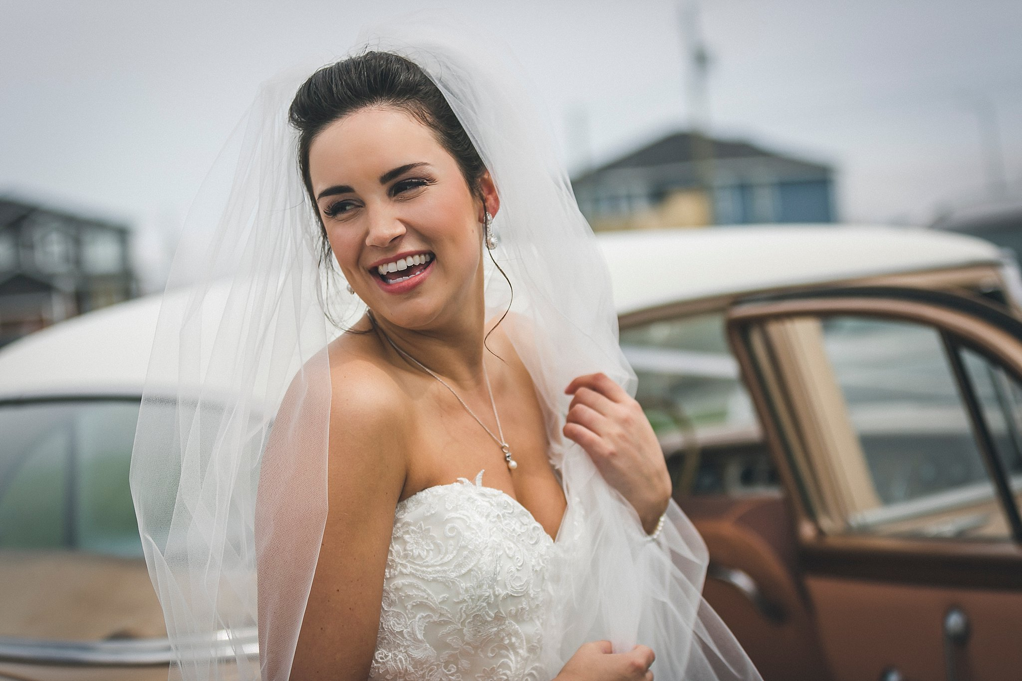 Stunning image of bride waiting to go to her St. John's, Newfoundland wedding in a Maggie Sottero wedding dress.