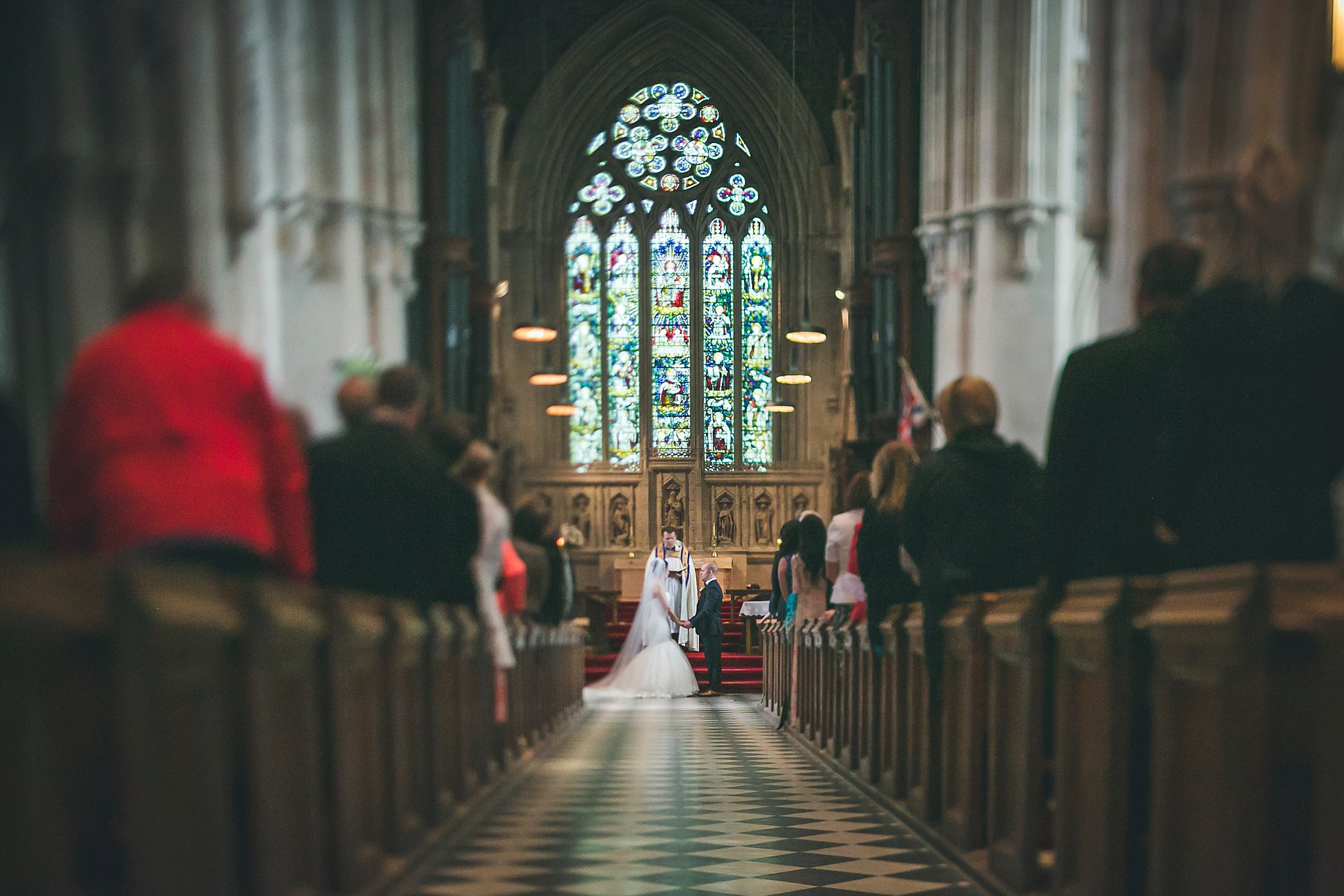 Bride and Groom at the alter in the Anglican Cathedral during a St. John's, Newfoundland wedding.