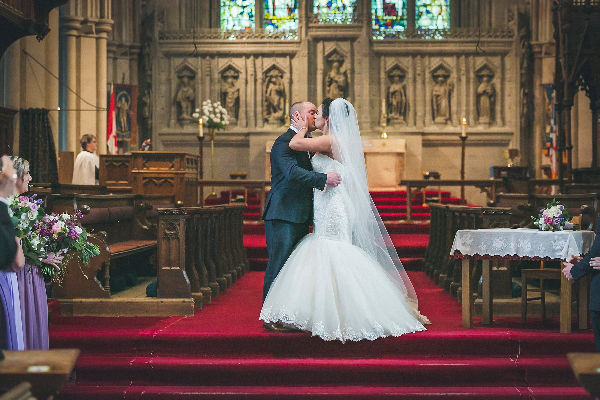 Bride and Groom's first kiss at the alter in the Anglican Cathedral during a St. John's, Newfoundland wedding.