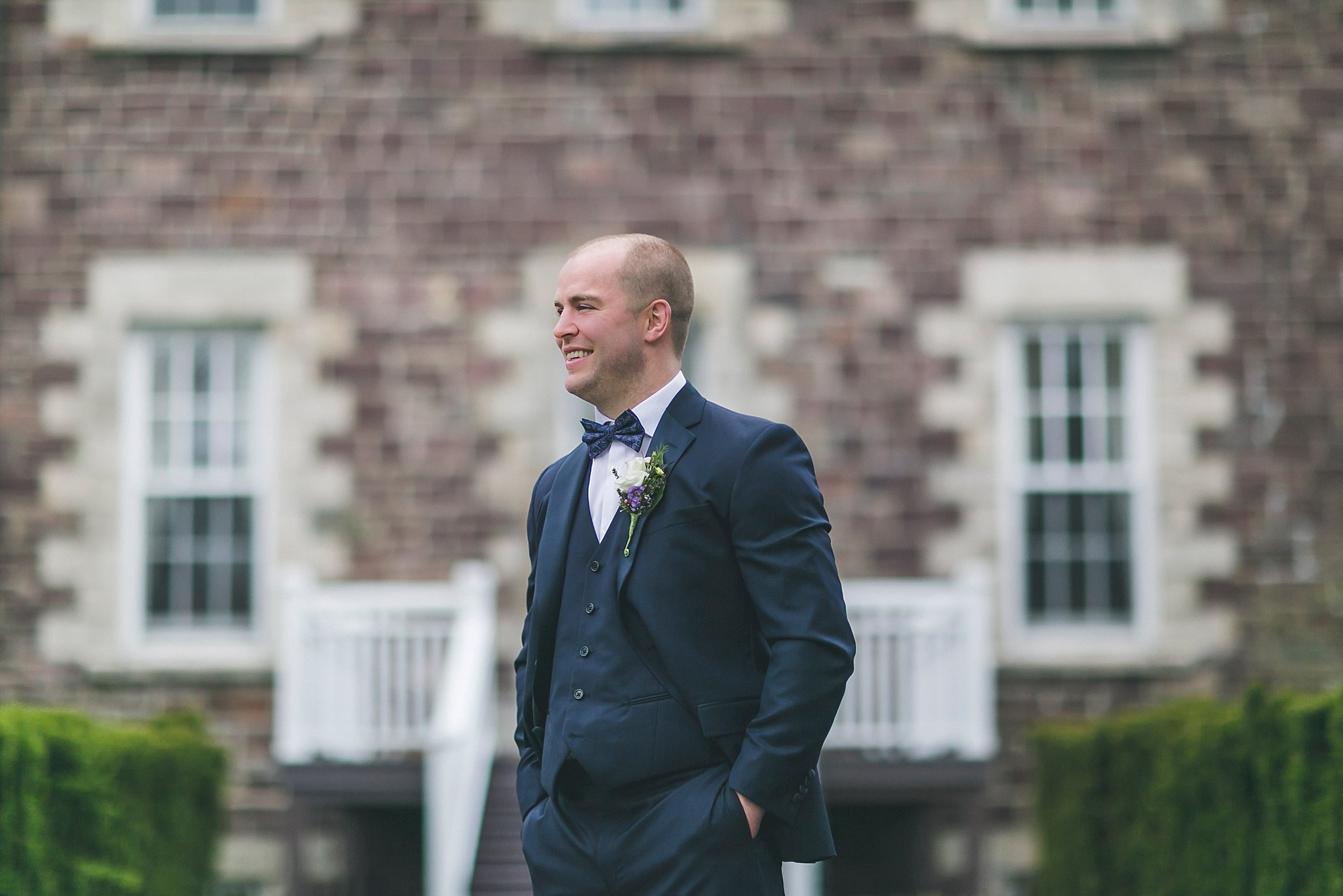 Groom outside Government House during a St. John's, Newfoundland wedding