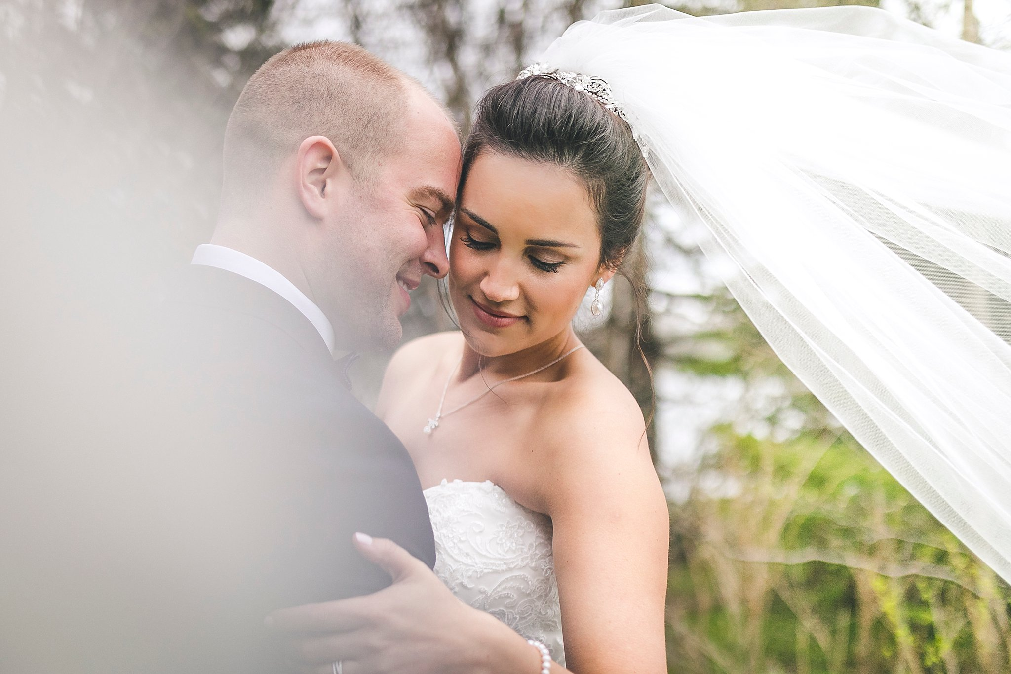 Intimate moment between Bride and Groom in Pippy Park during a St. John's, Newfoundland wedding
