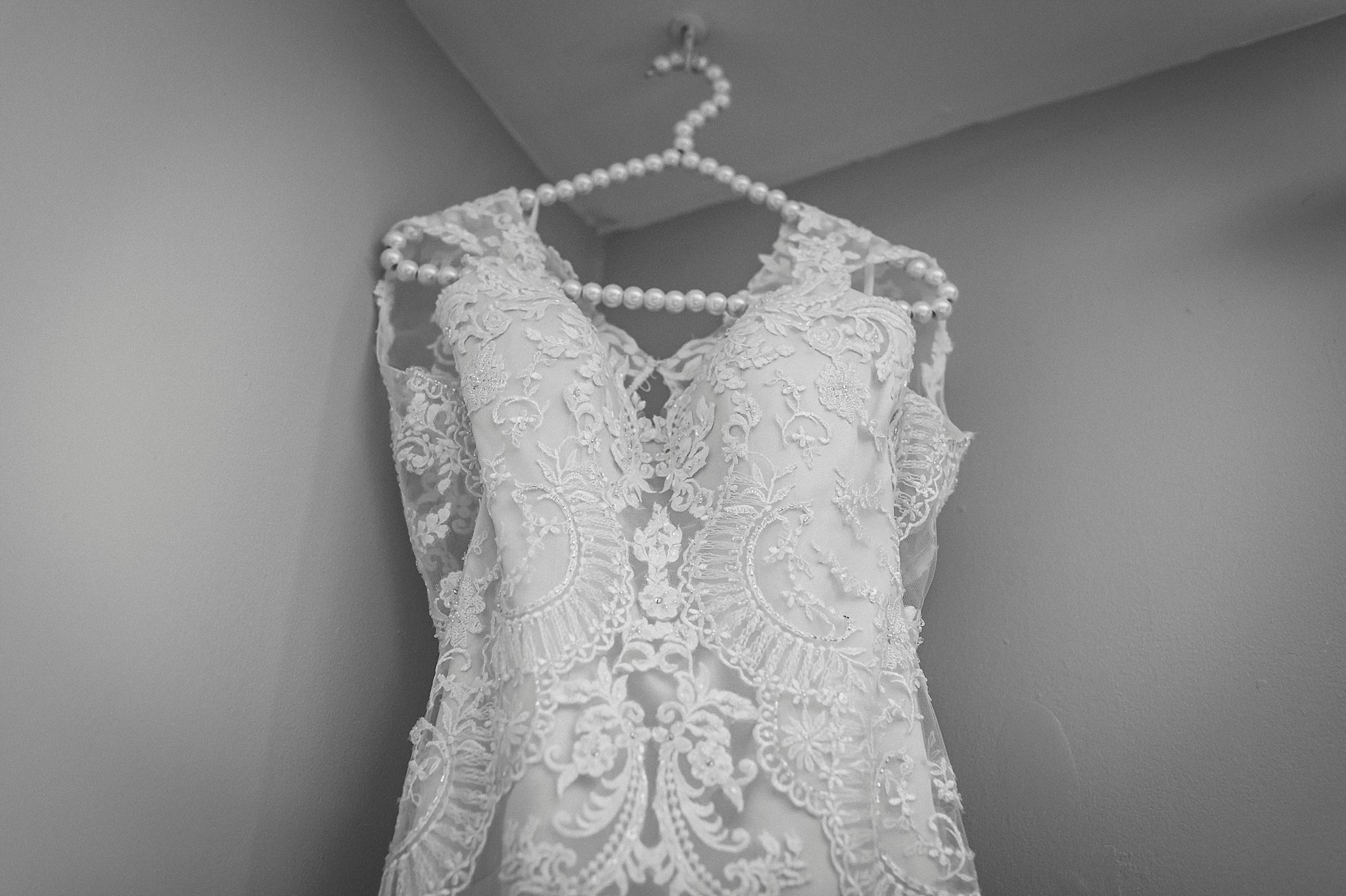 Casablanca Bridal Wedding dress hangs in the corner before wedding day in St. Johns, Newfoundland