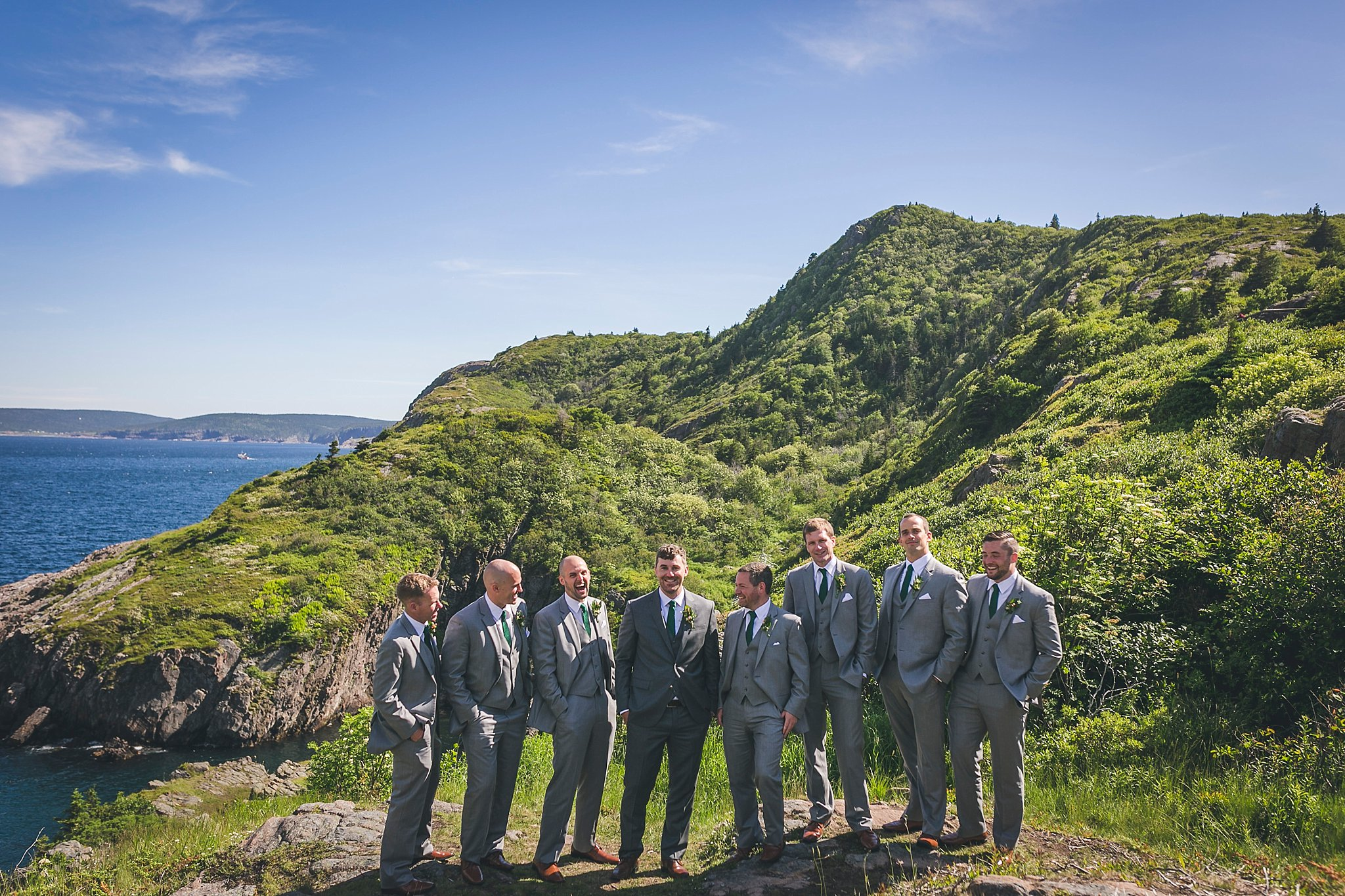 Groom and his groomsmen share a laugh at Cuckhold's Cove during their wedding in St. John's, Newfoundland.