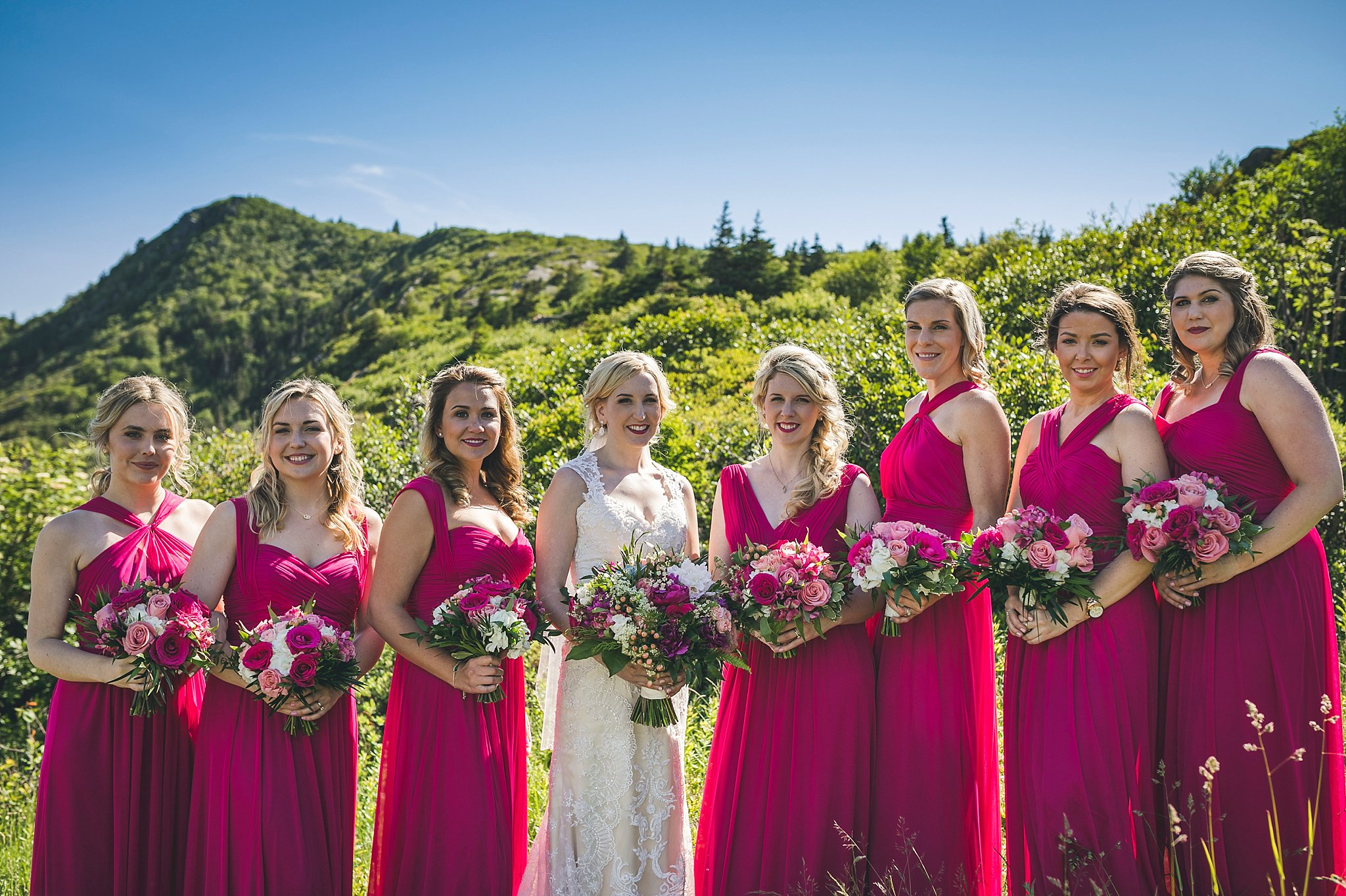 Bride in her Casablanca wedding dress and her Bridesmaids celebrate during a St. John's, Newfoundland wedding.