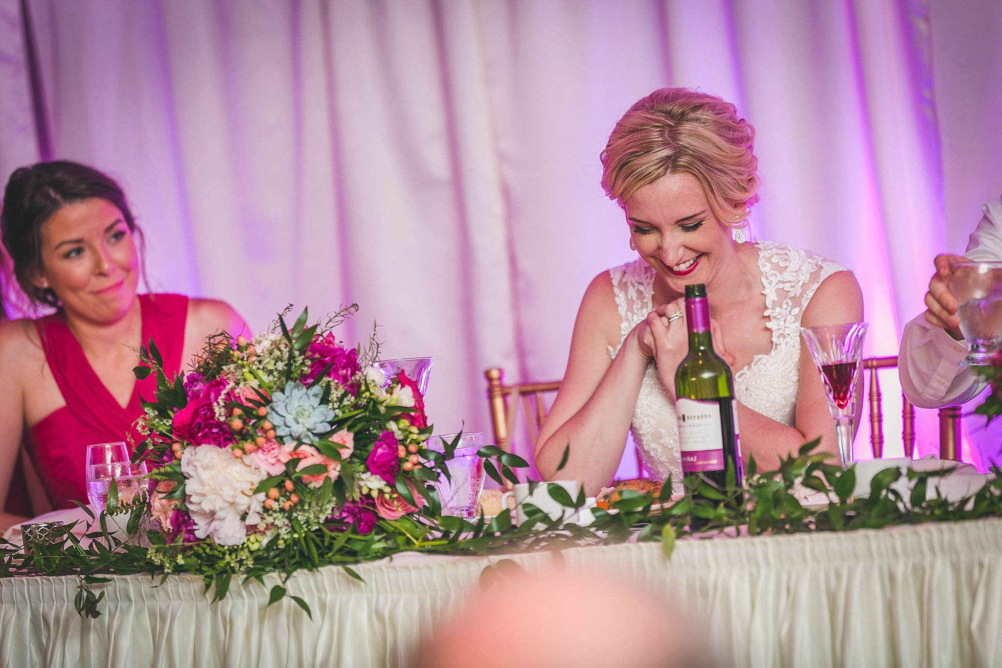 Bride laughs during the reception in Glendenning at her Newfoundland wedding