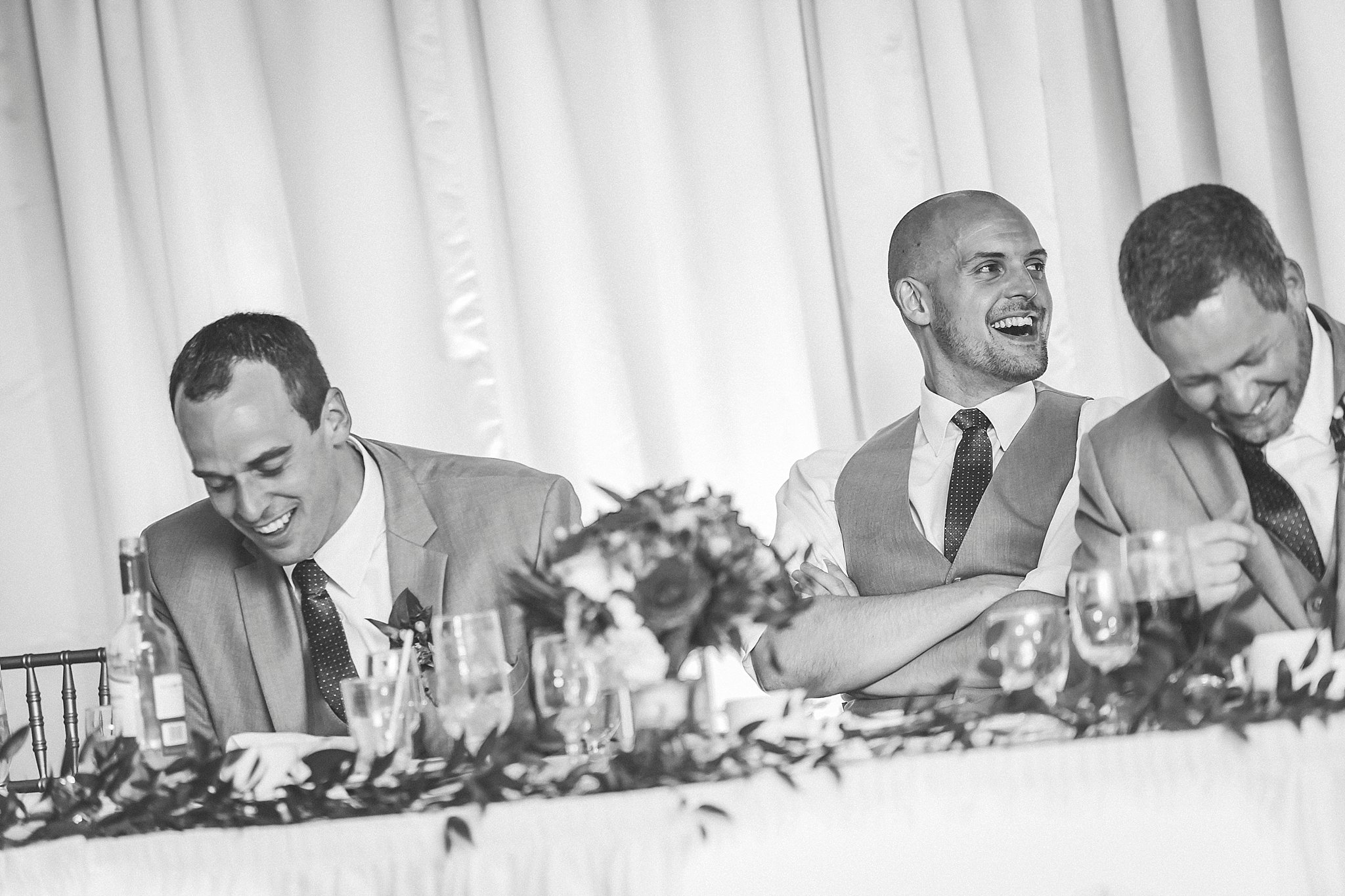 Groomsmen laugh at the reception in Glendenning during a Newfoundland wedding.