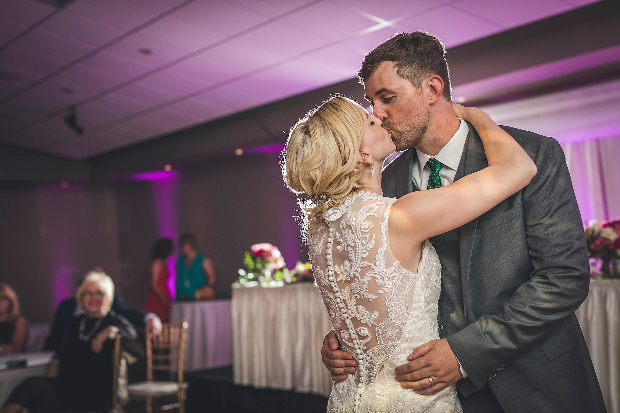 Bride and groom share a kiss during their first dance at their Newfoundland wedding held in St. John's