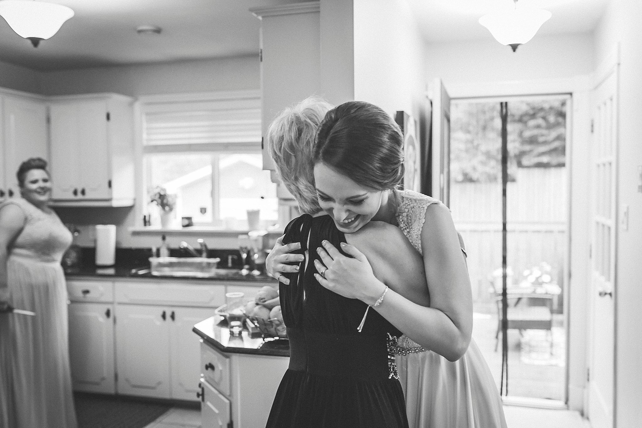Bride and mother share a hug before a Newfoundland wedding in St. John's