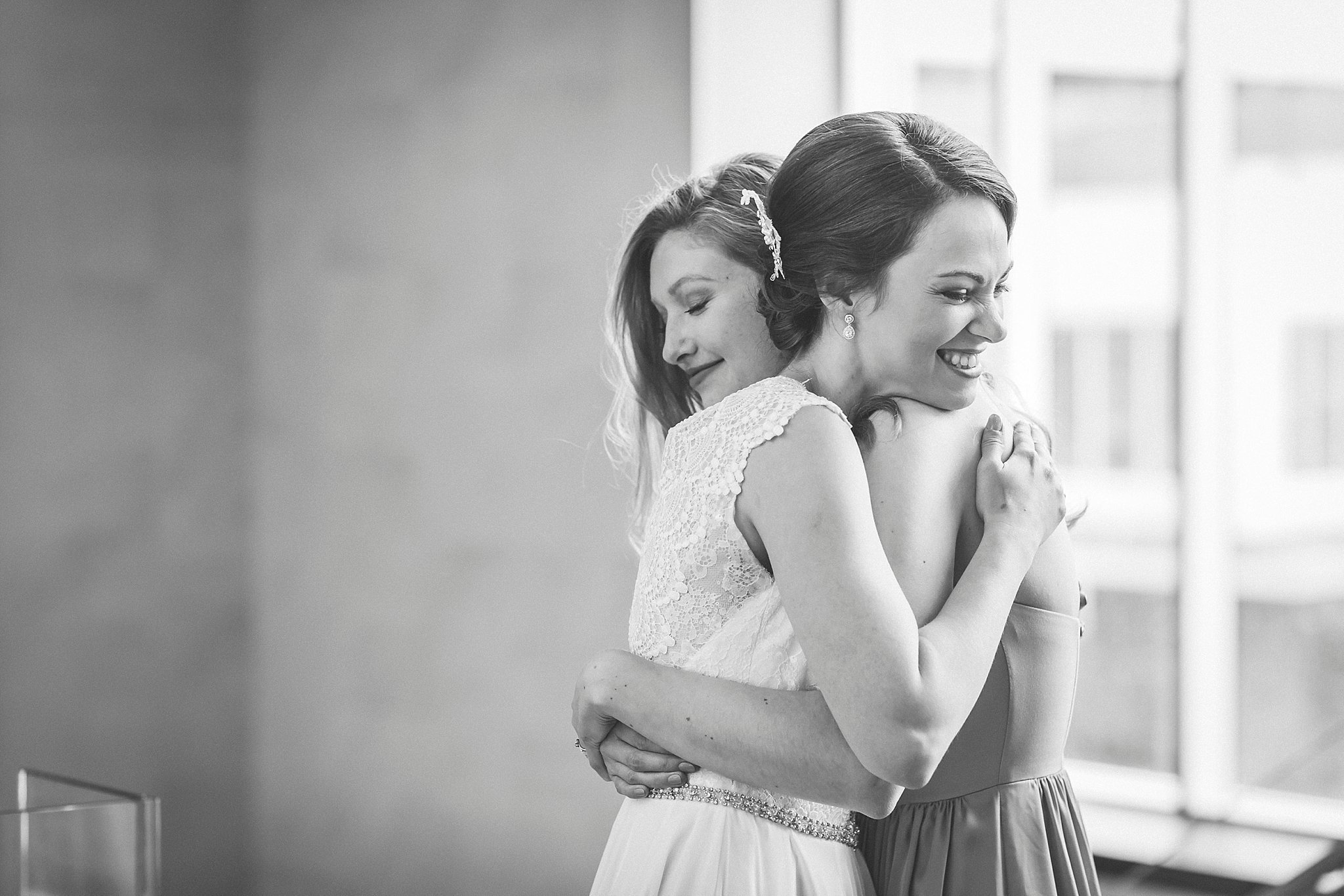 Bride and future sister-in-law hug during her St. John's, Newfoundland wedding.