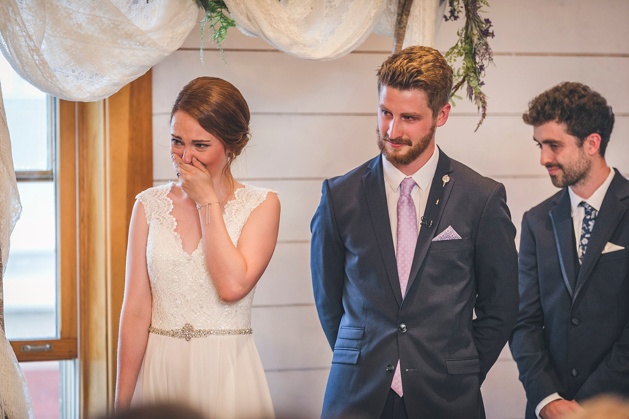 Bride reacts to speeches at her wedding at the Rocket Room in downtown St. John's, Newfoundland