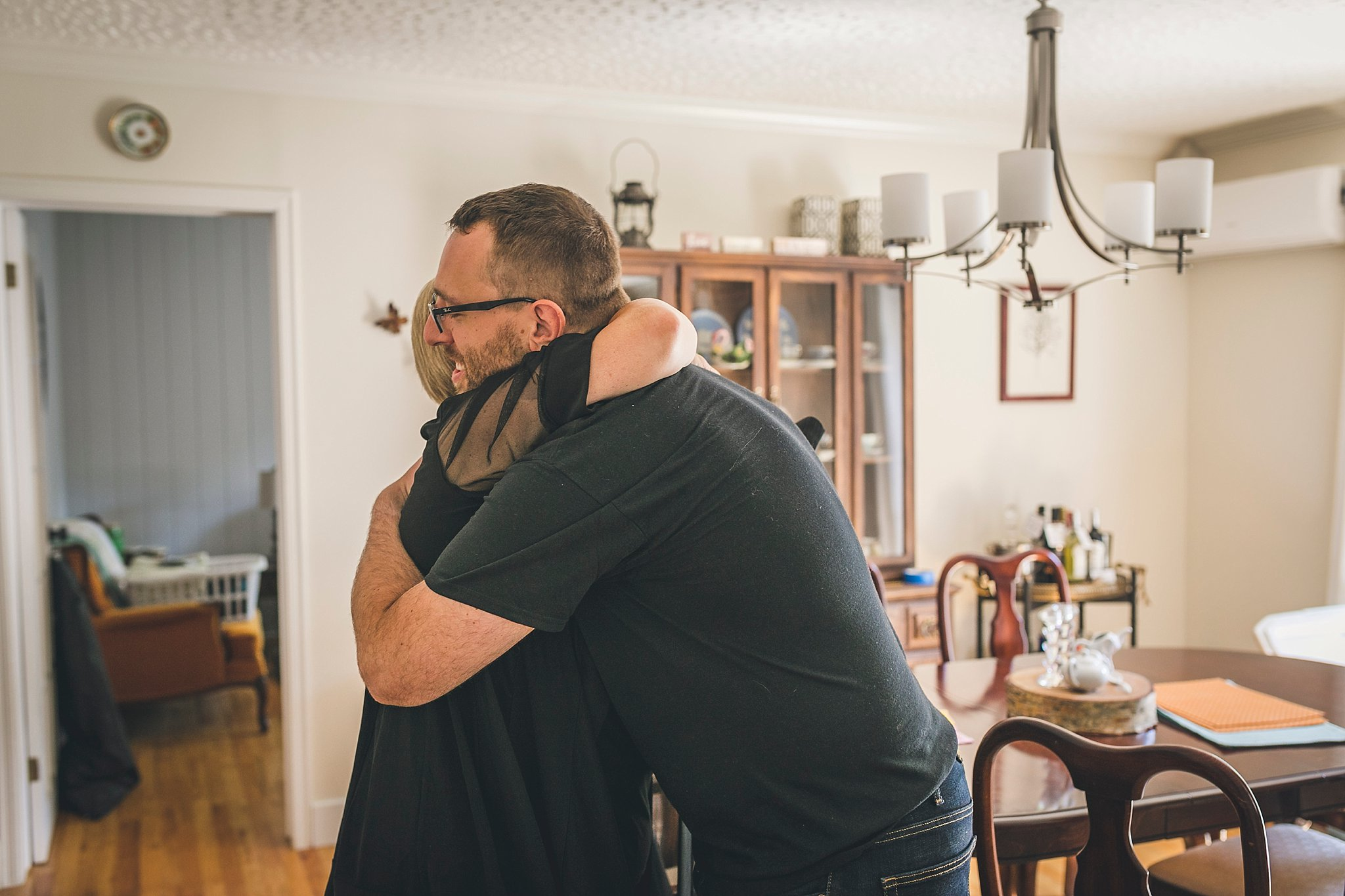 Groom and his mother share a hug prior to his wedding held in St. John's
