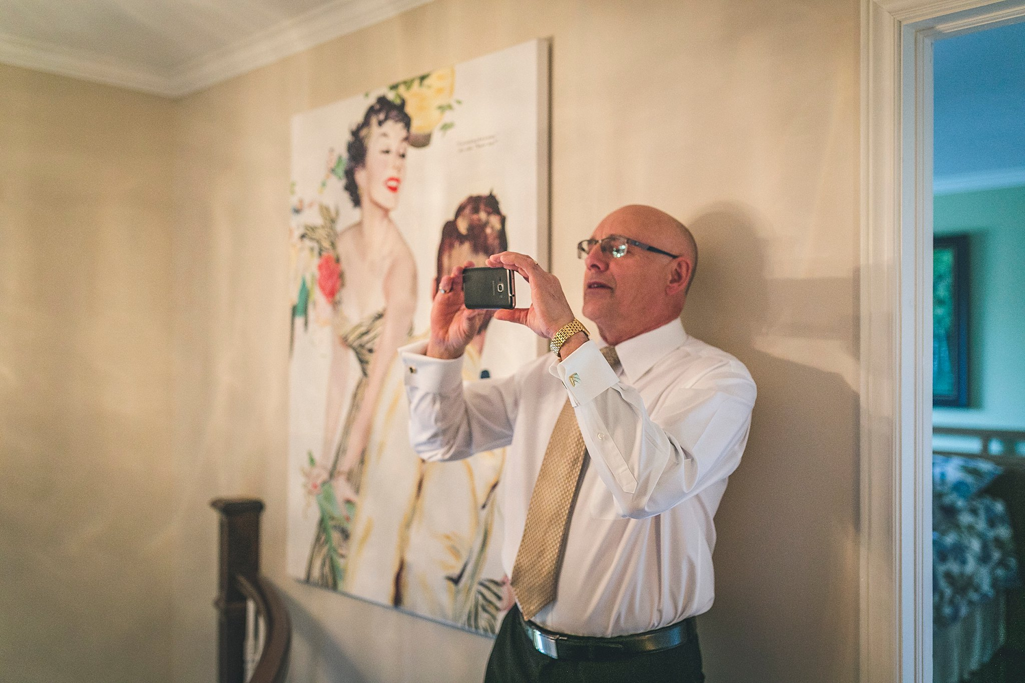 Father of the Bride happily photographs his daughter on her St. John's Wedding Day
