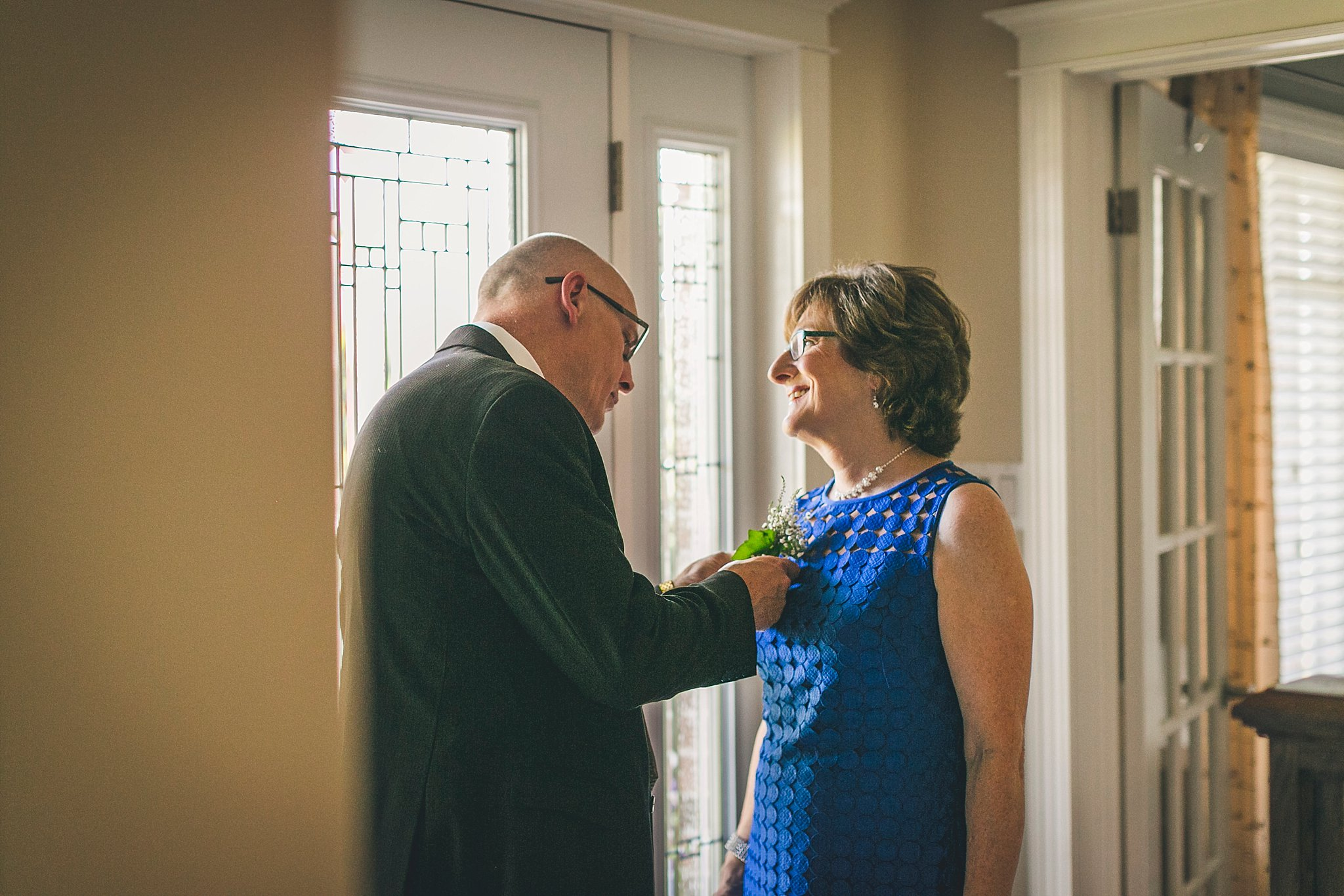Parents of the bride share a moment prior to the St. John's wedding