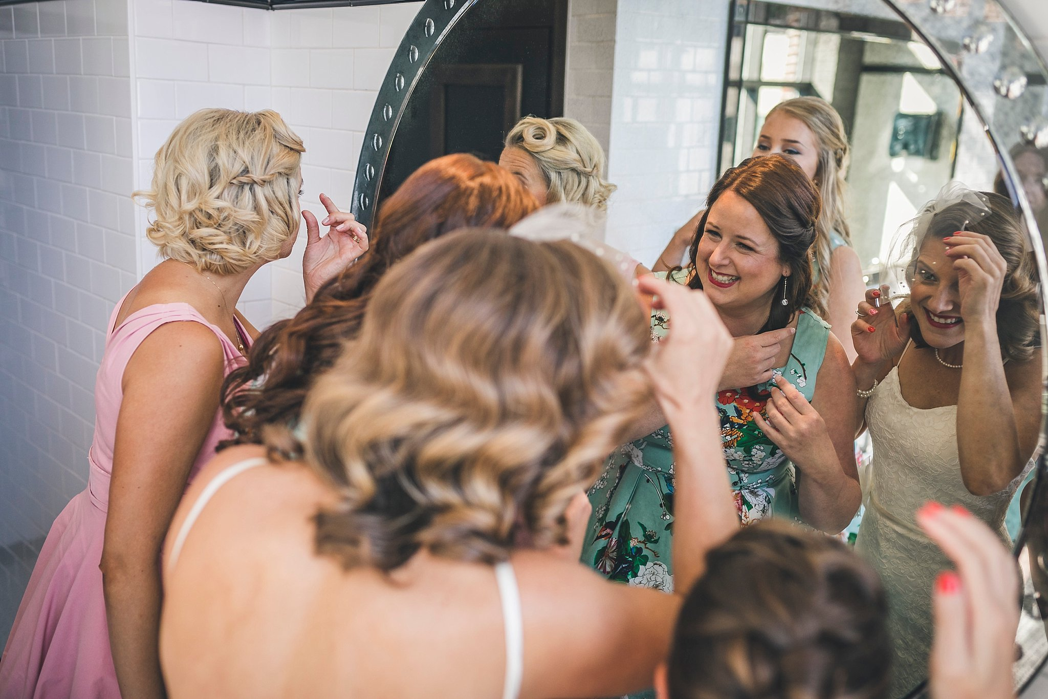 Bride and her bridesmaids fix their makeup prior to a St. John's, NL wedding