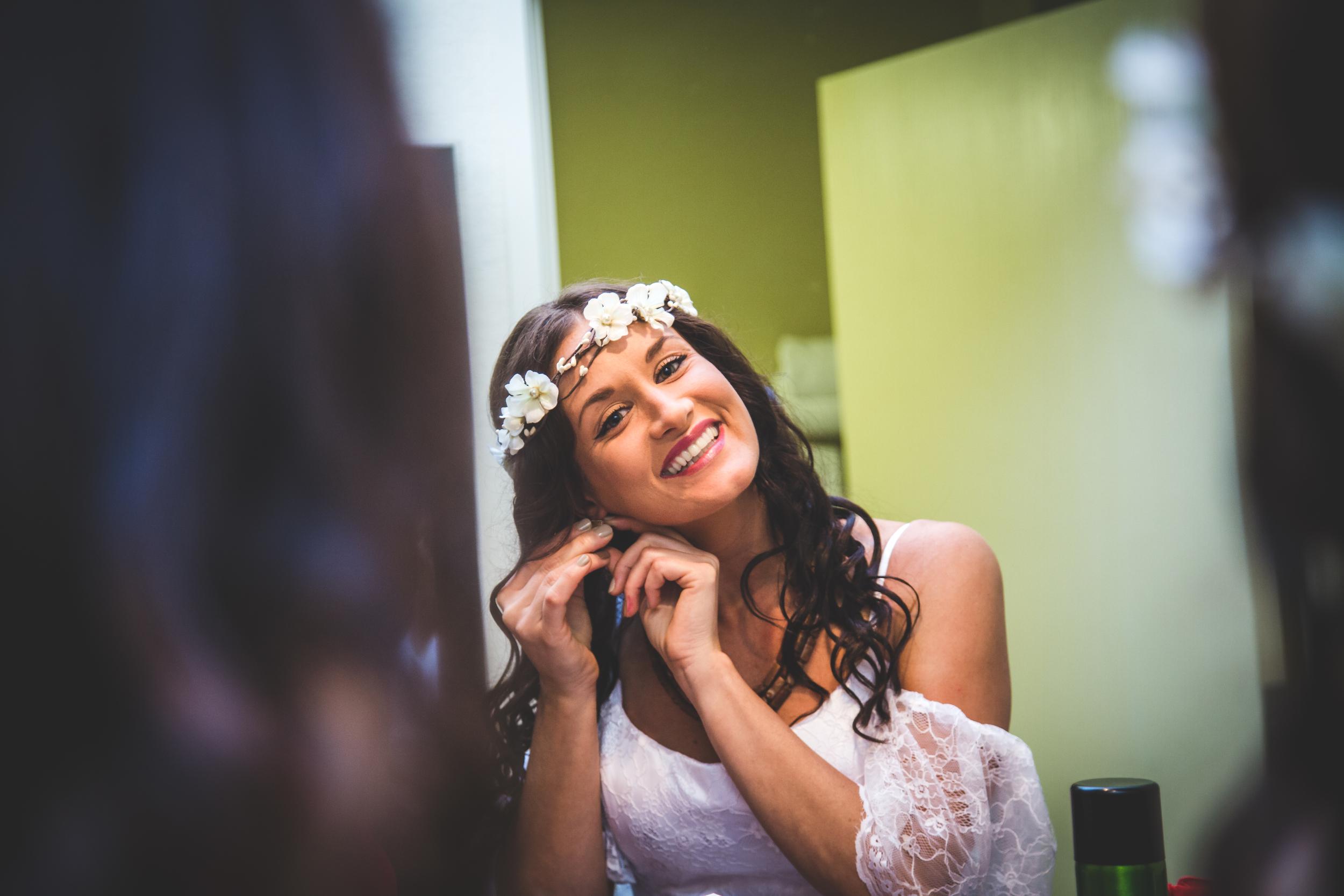 Bride smile with earrings-5041.jpg