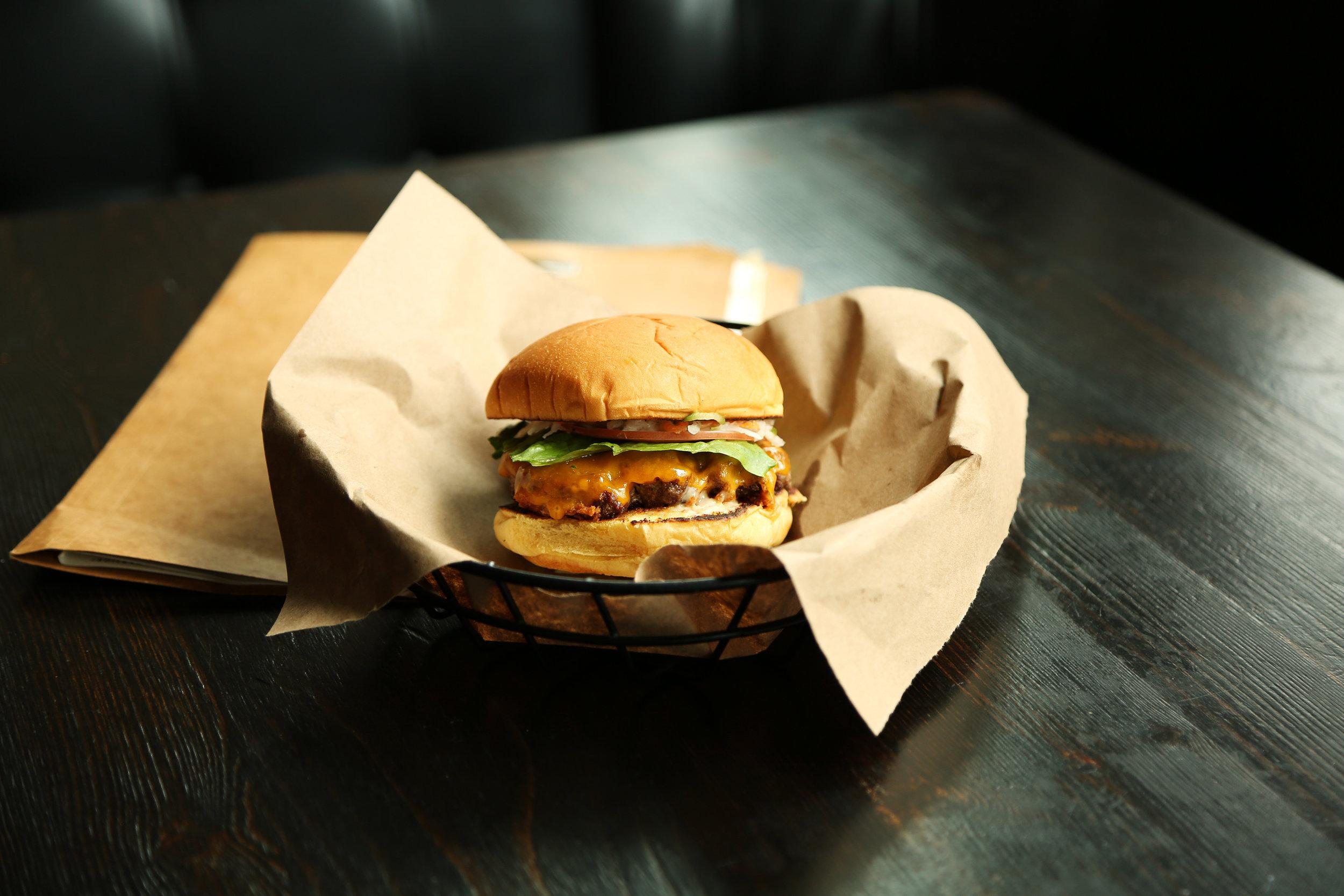 Single burger with cheese  . Photo credit Joslyn Blair.