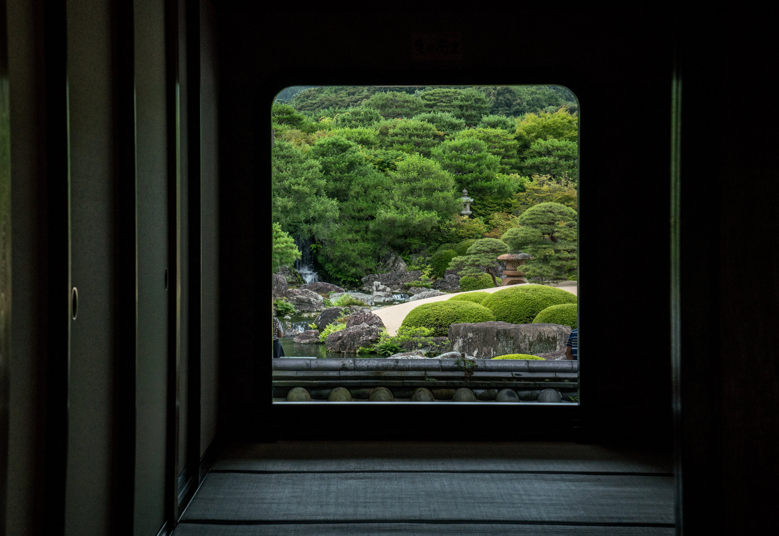 "Tokonoma  alcoves traditionally feature a hanging scroll of calligraphy or fine art. Here, left open, the alcove features a ""living scroll"" affording an ever changing view of the adjacent garden."