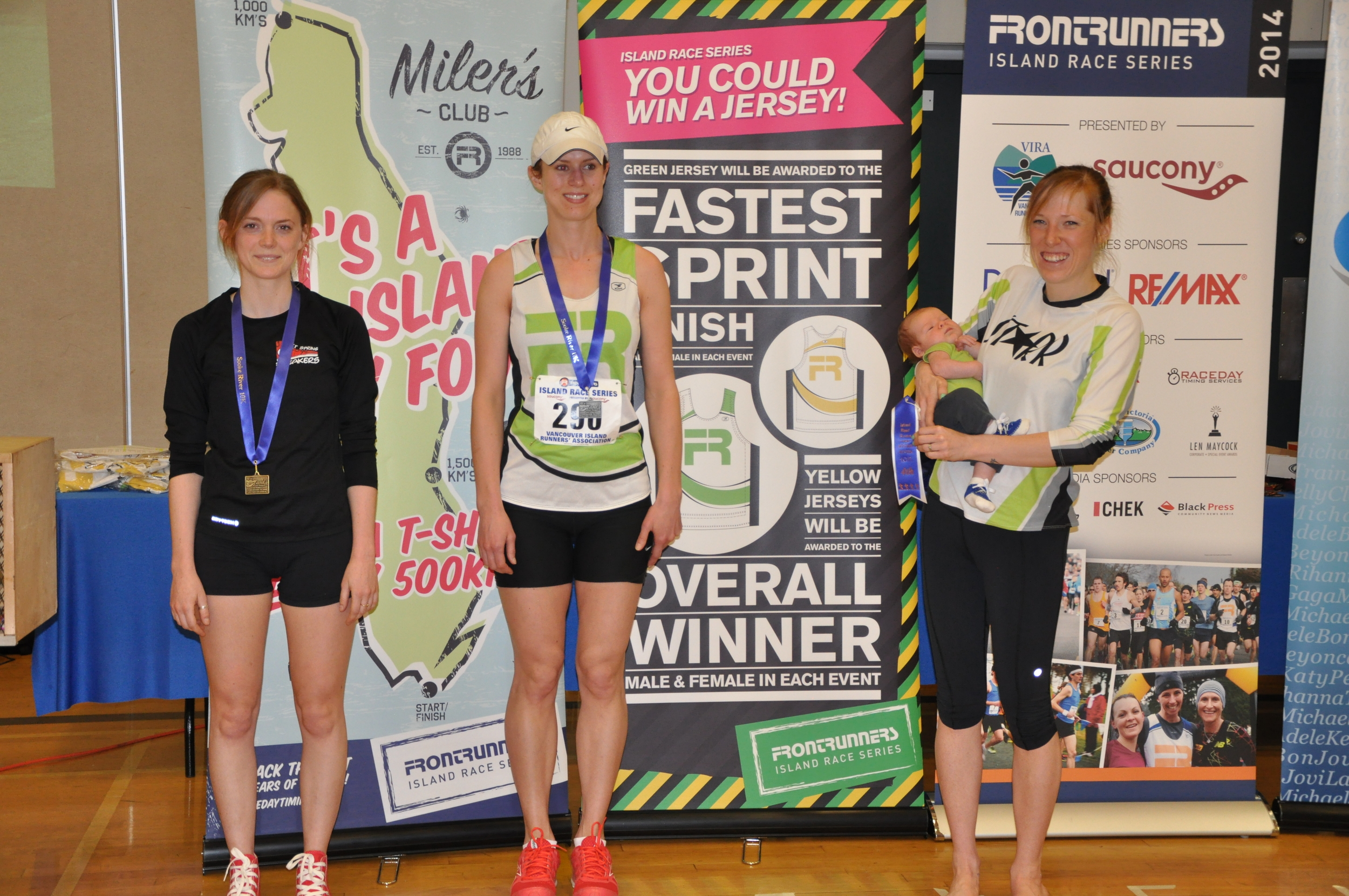 Sara-Mae (and son) accepting her Age Group award at the Sooke (Island Series)10km - 2014