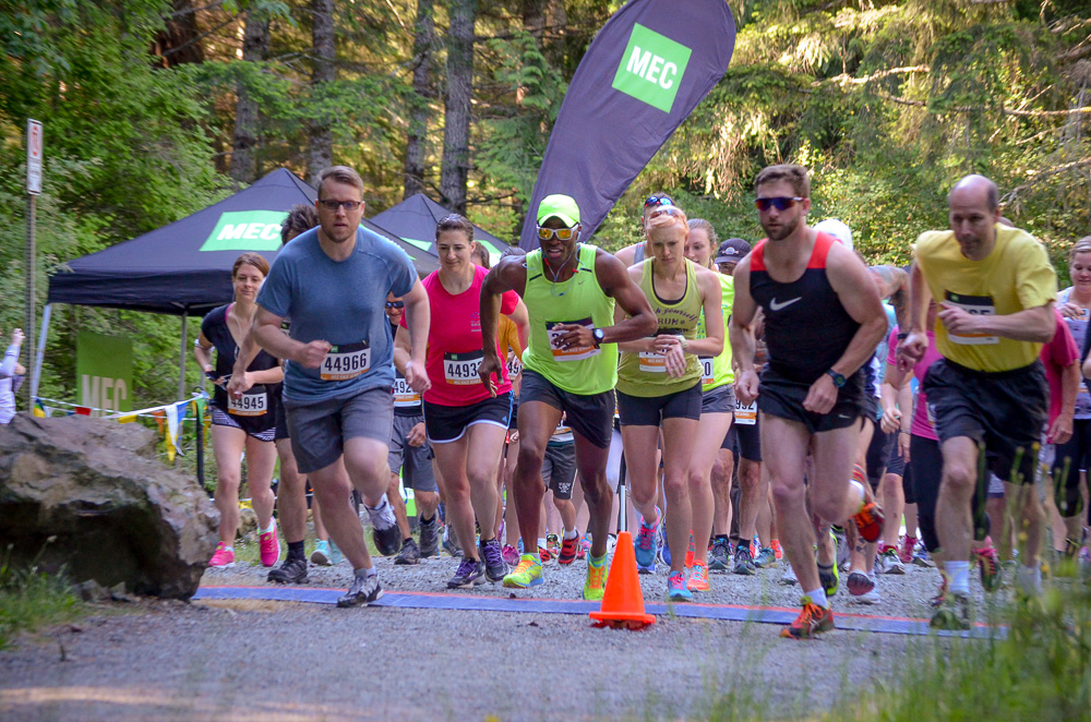 Amanda (center female in green singlet) racing the MEC Tape Breaker 5km - June 2015