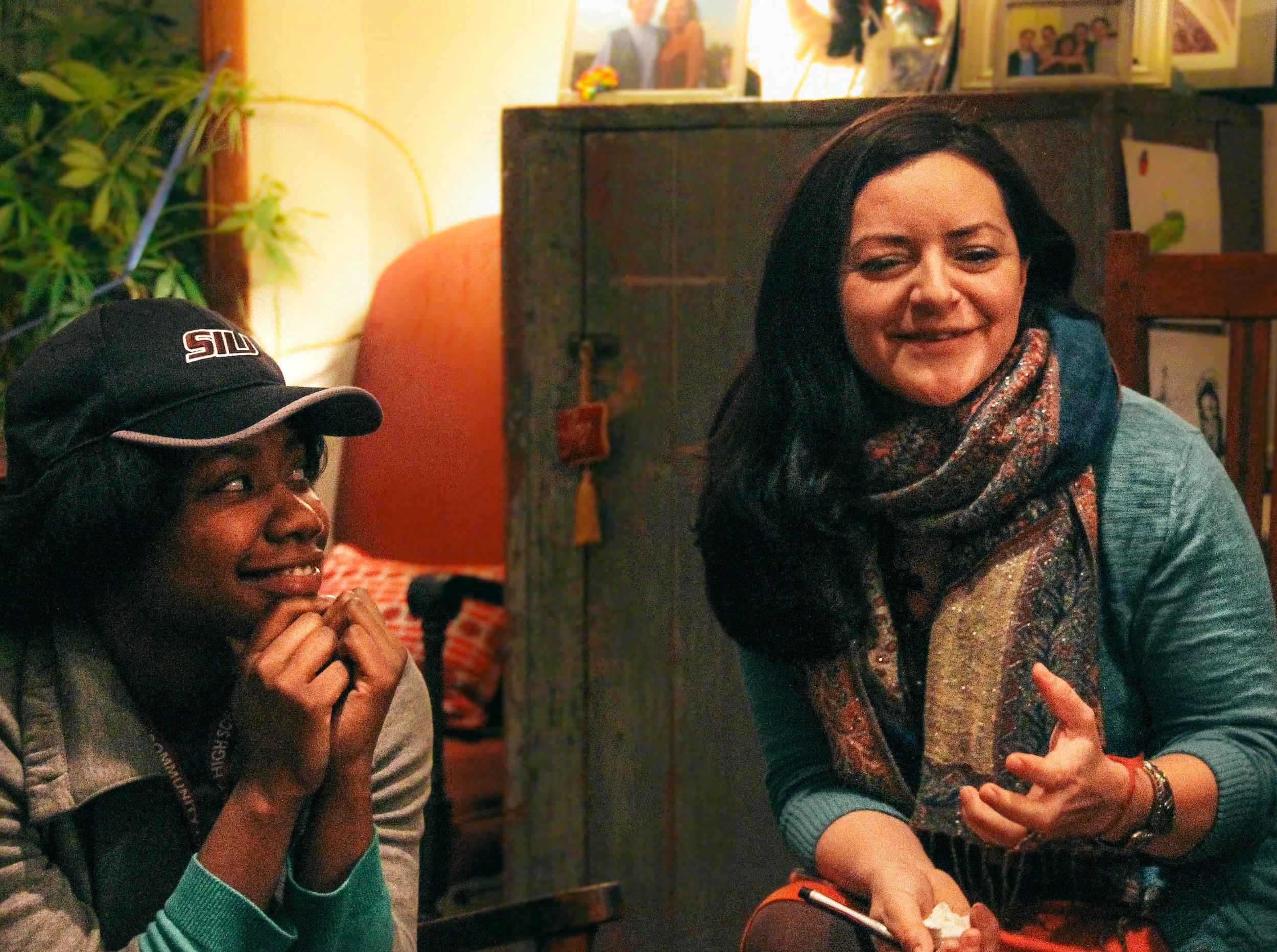 Peace Fellow Briana Johnson (left) listening to Peace Activist  Lau Ramirez   (right)share her story.