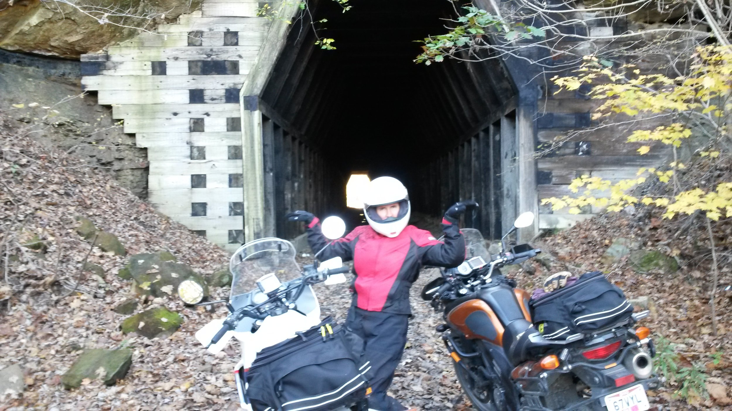At the far end of King Hollow RR Tunnel. Slick clay, good-sized puddles, and dark as night after bright sunlight. Best experienced on foot.