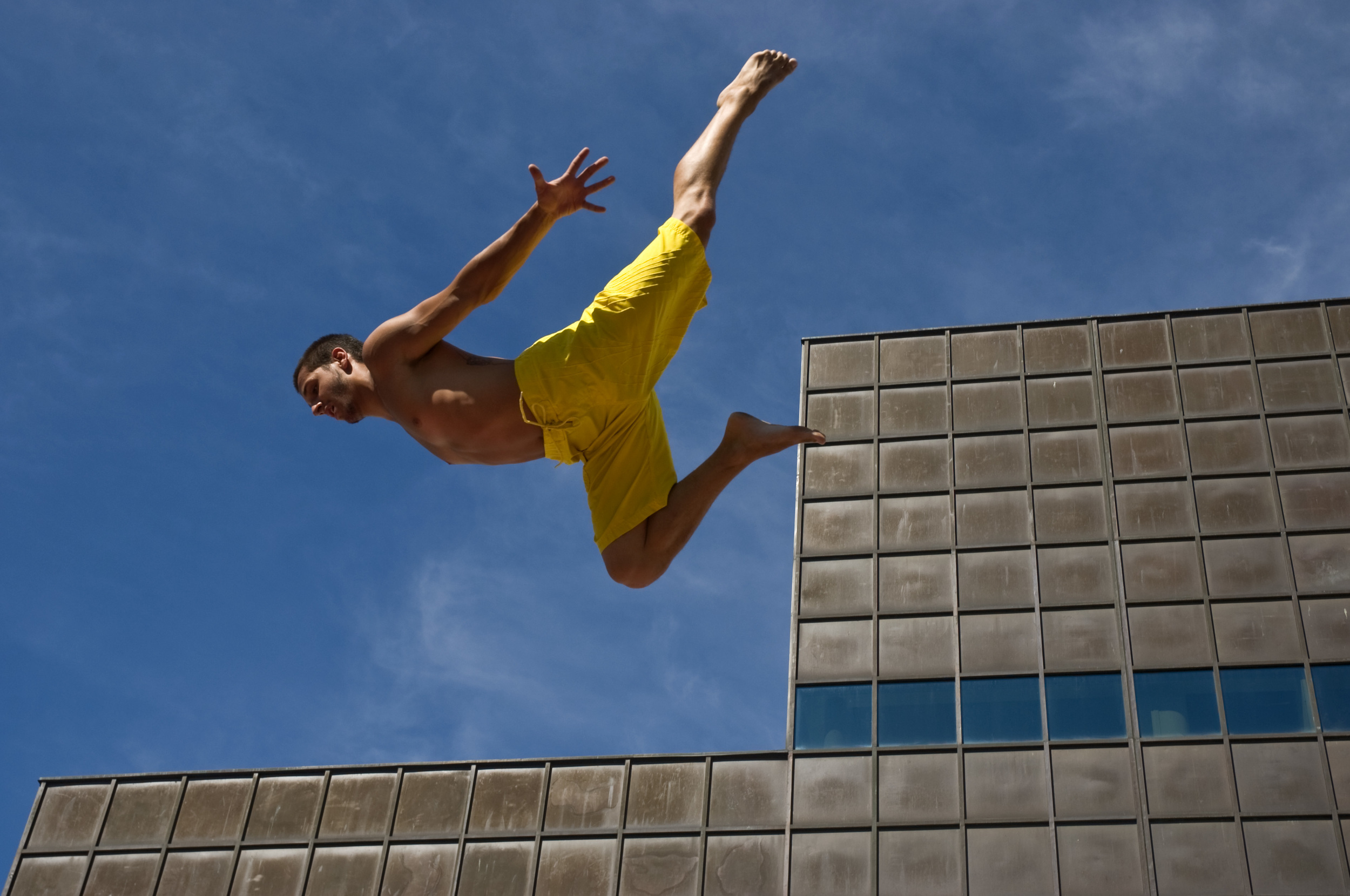An aerial performer practices on a trampoline before the start of the Francofolies, a huge street celebration of French Canadian culture in Montreal, Quebec.
