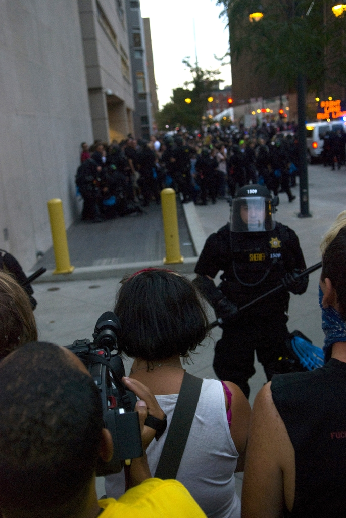 Police officers stand guard around a group of protesters in Denver during the 2008 Democratic National Convention. This controversial policing technique is known as 'kettling' and involves the police encircling a group and detaining them en masse.
