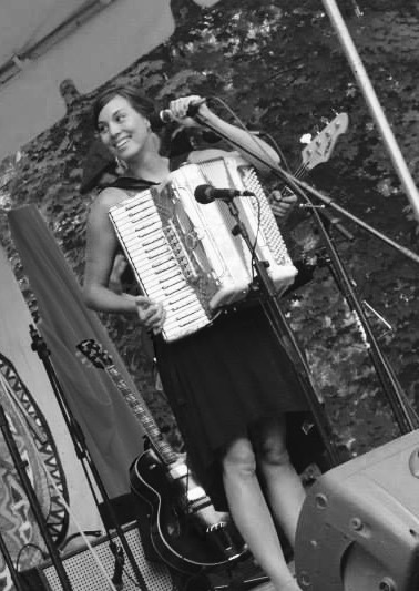 Meagan sings and plays the accordion at the Take Me To The River family music festival in 2013.