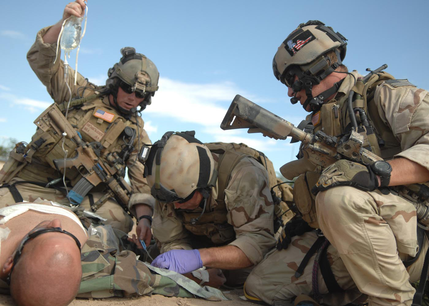 Field medic saving the life of an injured soldier