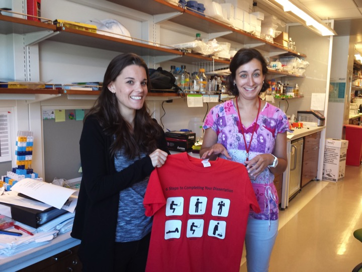 The traditional passing of the dissertation T-shirt as Gwen graduates!  (left to right) Gwen Buel, Joana Nunes  September 2016