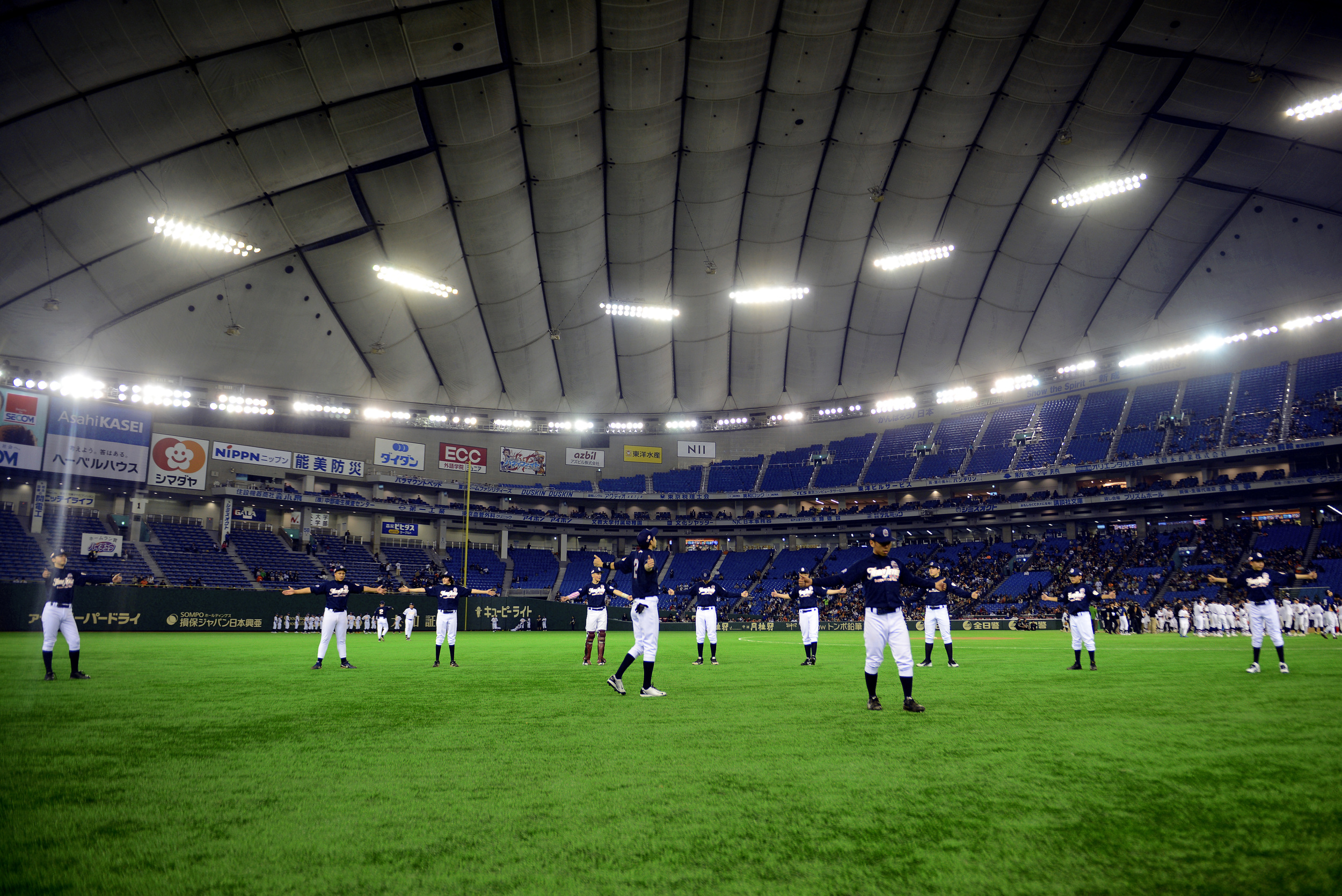 Players from Team Jeter warm up before the Tomodachi Charity Baseball Game, March 21, 2015 at the Tokyo Dome, Japan. Team Jeter played against Team Matsui in an effort to raise awareness about children affected by the Great East Japan Earthquake. (U.S. Air Force photo by Airman 1st Class Delano Scott/Released)