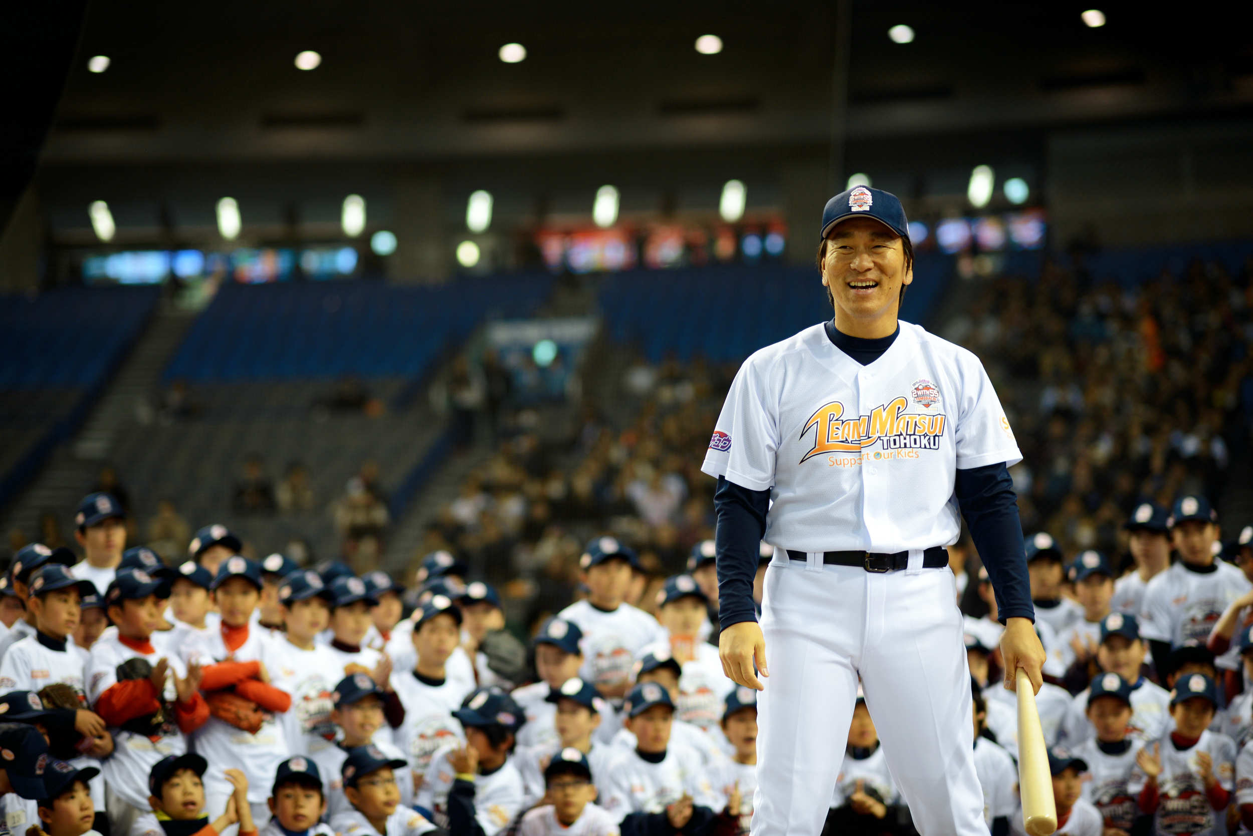 Hideki Matsui, retired New York Yankees baseball player, demonstrates how to hit a baseball for children during the Tomodachi Charity Baseball Game, March 21, 2015, at the Tokyo Dome, Japan. The game helped to raise awareness for children impacted by the Great East Japan Earthquake. (U.S. Air Force photo by Airman 1st Class Delano Scott/Released)