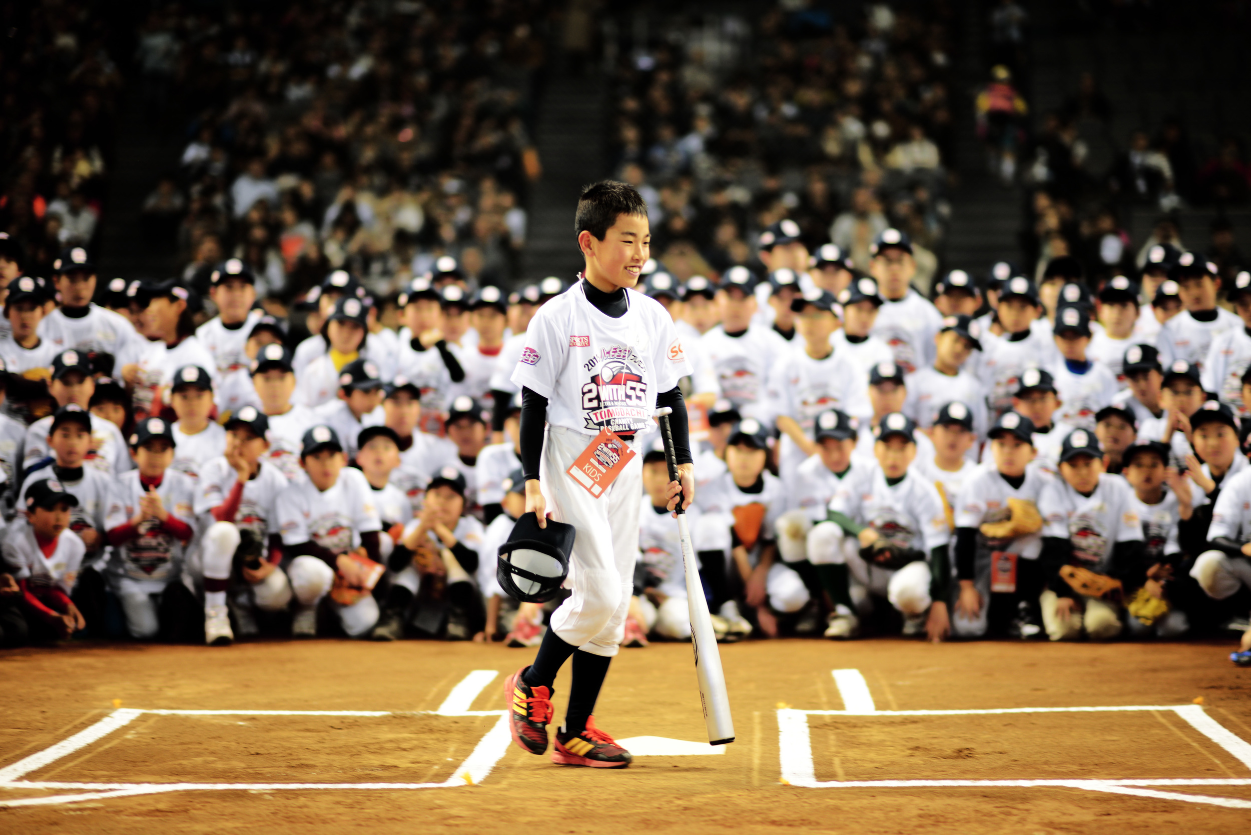 A child prepares to hit a baseball during a batting clinic taught by Derek Jeter and Hideki Matsui, March 21, 2015, at the Tokyo Dome, Japan. The former Yankees teammates partnered once more for the Tomodachi Charity Baseball. (U.S. Air Force photo by Airman 1st Class Delano Scott/Released)
