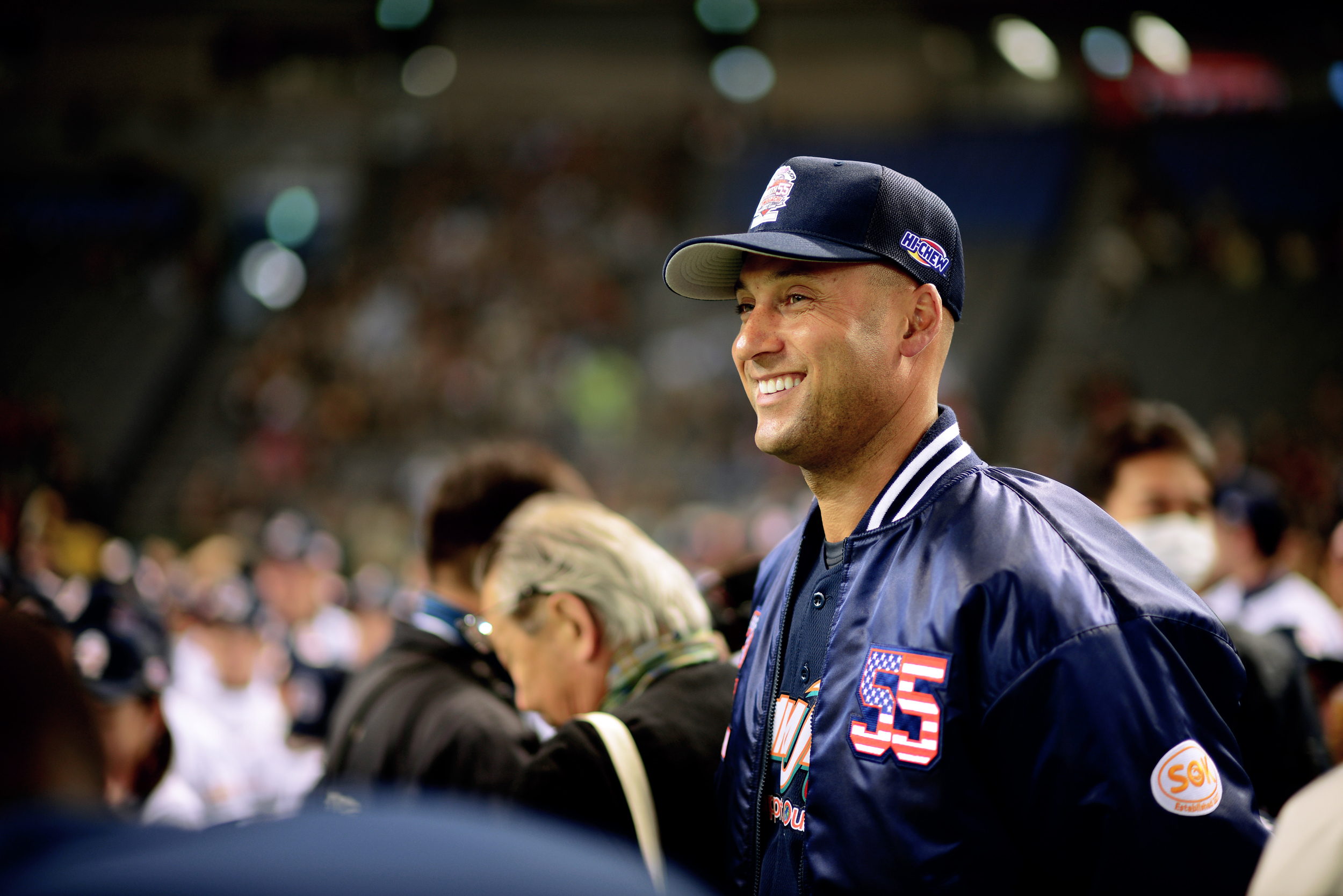 Derek Jeter, retired New York Yankees baseball player, walks to congratulate Team Matsui for their victory in the Tomodachi Charity Baseball Game, March 21, 2015, at the Tokyo Dome, Japan. Team Jeter played against Team Matsui in the three-inning contest, which raised awareness for victims affected by the Great East Japan Earthquake. (U.S. Air Force photo by Airman 1st Class Delano Scott/Released)