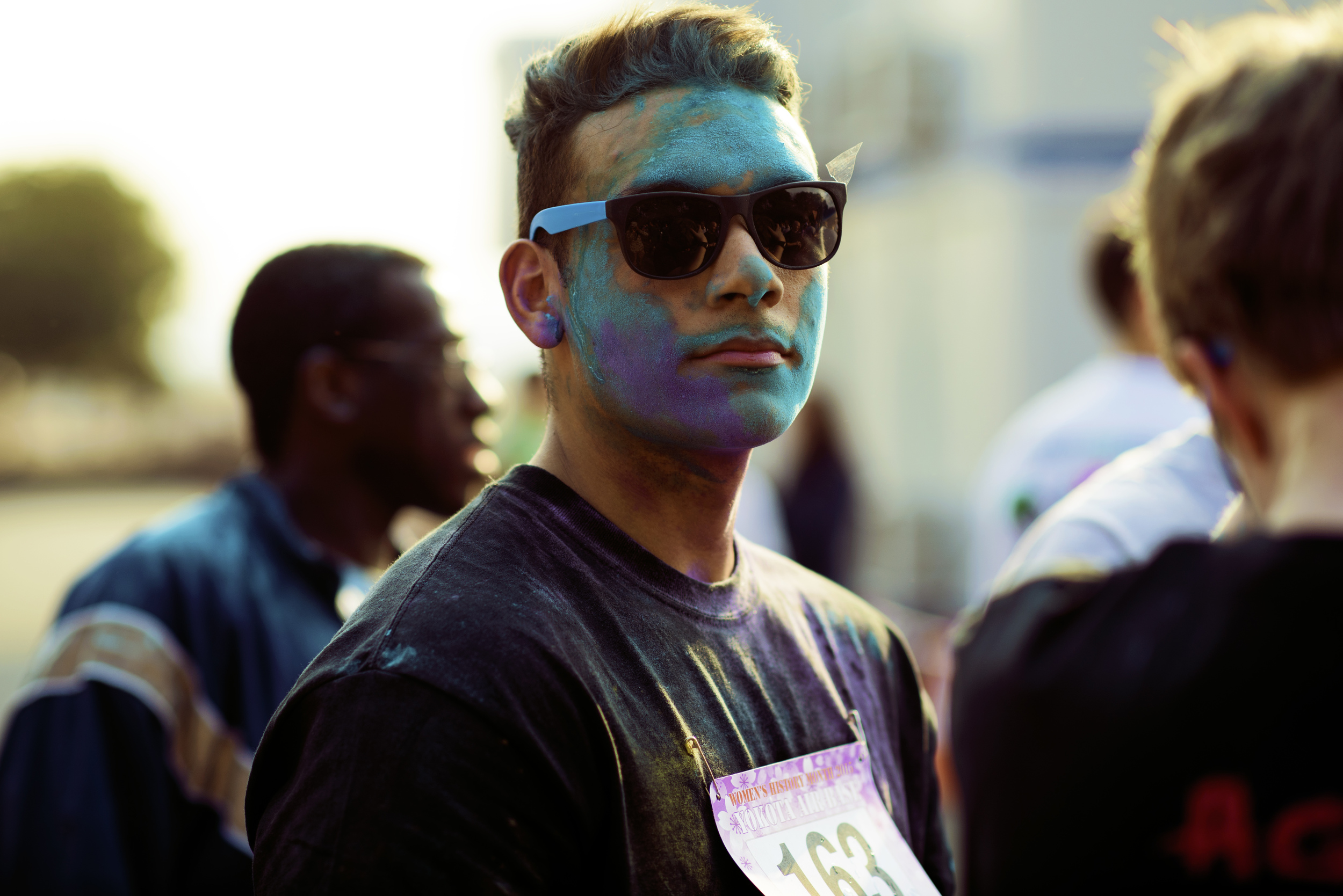 An Airman poses after running in the Women's History Month Wing Color Run, March 13, at Yokota Air Base, Japan. The 5k run was in celebration of Women's History Month, which honors the accomplishments of women throughout history. (U.S. Air Force photo by Airman 1st Class Delano Scott/Released)