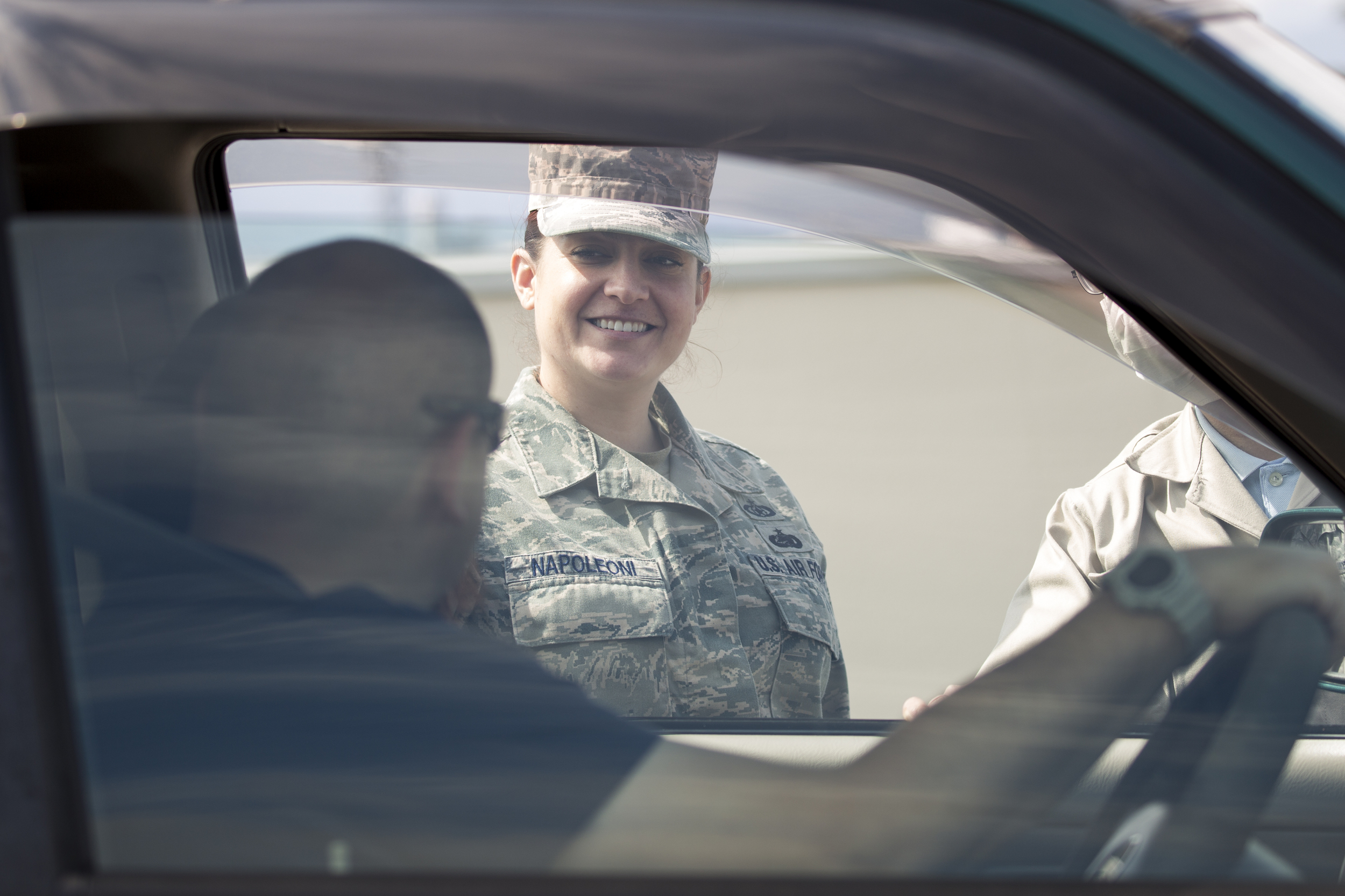 Tech. Sgt. Laury Napoleoni, 374th Airlift Wing Safety ground safety manager, talks to a driver during a safety week promotion at Yokota Community Center, March 4, 2015. The 374 Airlift Wing Safety held safety week from March 2 to 6. The safety week was designed to improve personal and wingman's safety. (U.S. Air Force photo by Osakabe Yasuo/Released)