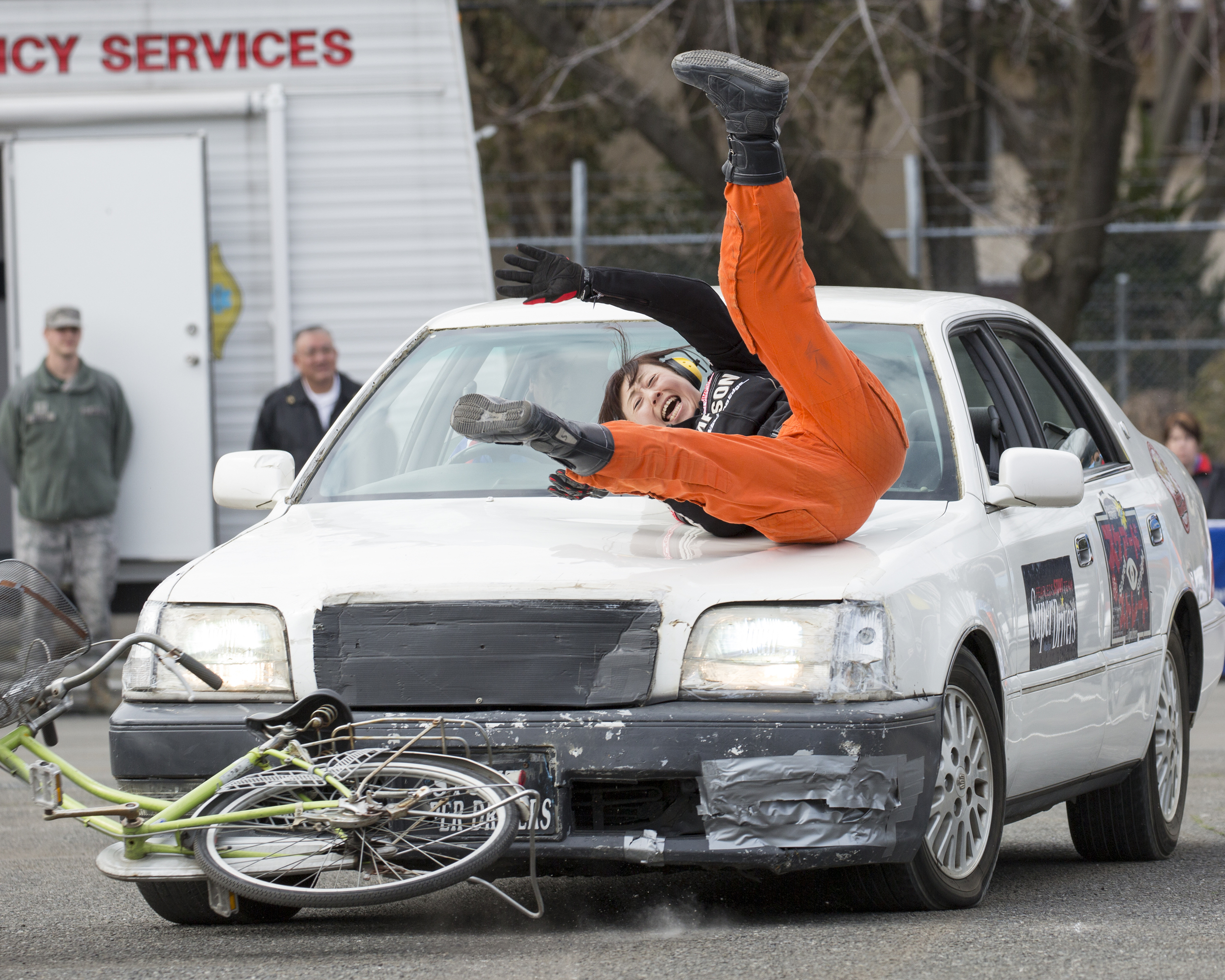 """A member from the stunt project team """"Super Drivers"""" performs a traffic safety demonstration during the safety festival at Yokota Air Base, Japan, March 6, 2015. The Fussa police station sponsored the traffic safety demonstration for Yokota residents during the festival. The event demonstrated hairy moments in car accidents. (U.S. Air Force photo by Osakabe Yasuo/Released)"""